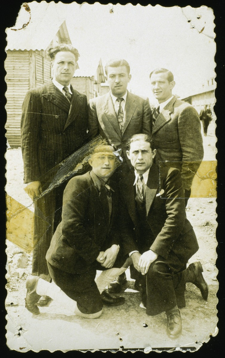 Group portrait of five male prisoners in the Pithiviers internment camp.  Among those pictured is Symon (Symcha) Finifter.