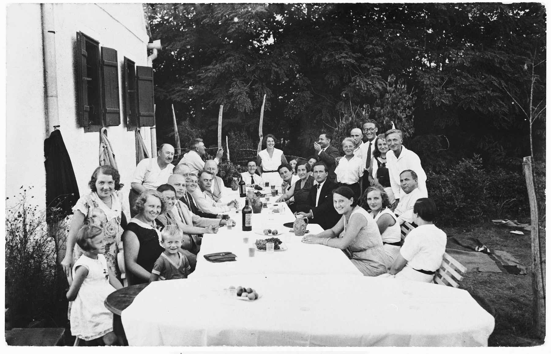 Jews and non-Jews attend a social gathering in the vineyard of Zvonko Kerstner in Ludbreg, Croatia  Among those pictured are Zvonko and Ivo Kerstner, Giza Deutsch and Ljudevit Vrancic.  The Kerstners owned a brick factory and helped protect Teodora Basch during the war.