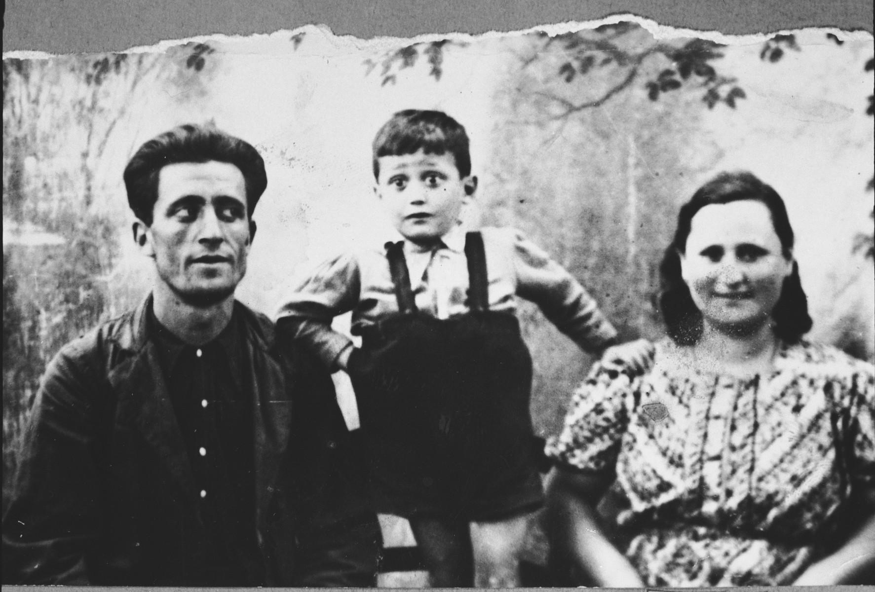 Portrait of Todoros Levi, son of Haim Levi, Todoros' wife, Sara, and [his son], Haim.  Todoros was a gardner.  They lived at Mitrovatska 7 in Bitola.