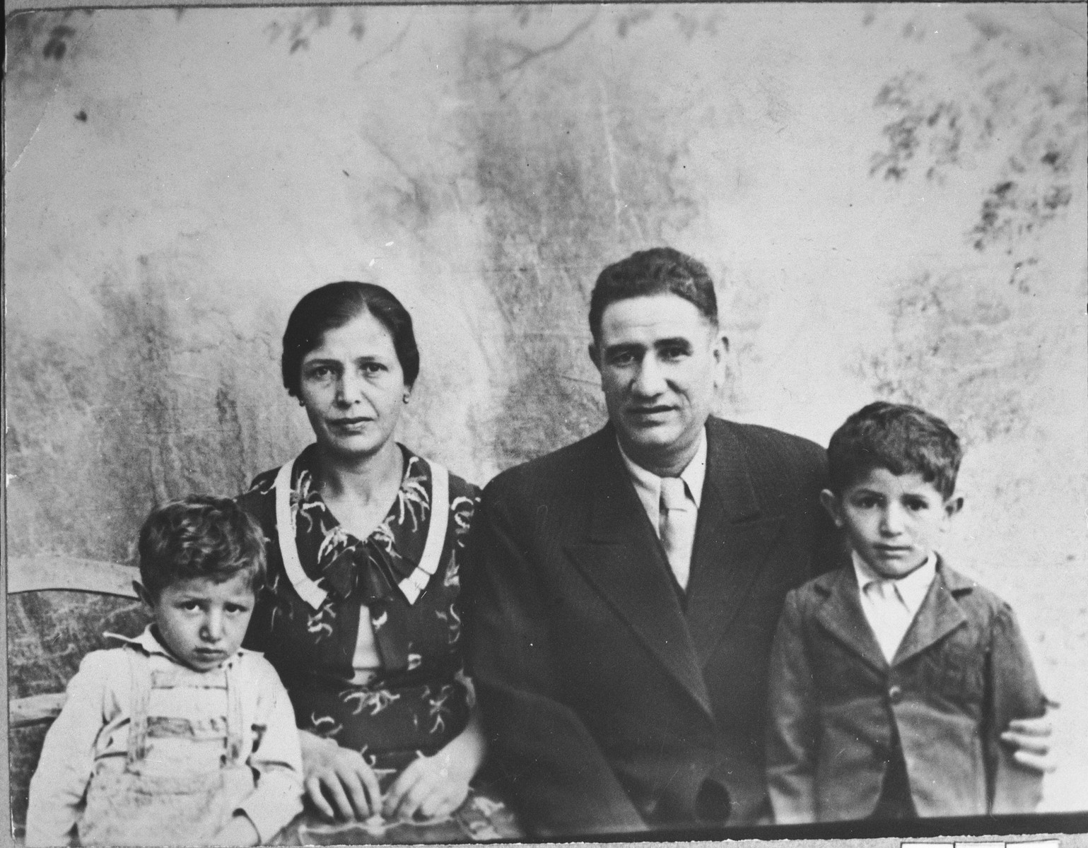 Portrait of Pinhas Kassorla, his wife, Arnesta, and children.  Pinhas was a second-hand dealer.  They lived at Zmayeva 8 in Bitola.