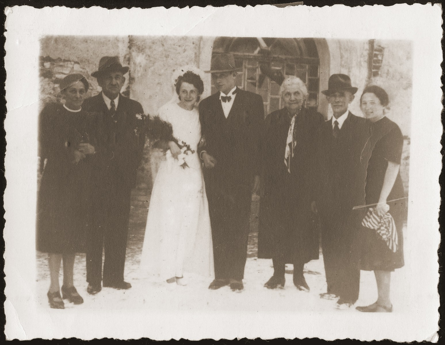 The wedding of Gera and Alfred Borchart in the Belzyce ghetto.  This photograph was sent by the Borcharts to Walter Jacobsberg in Shanghai.