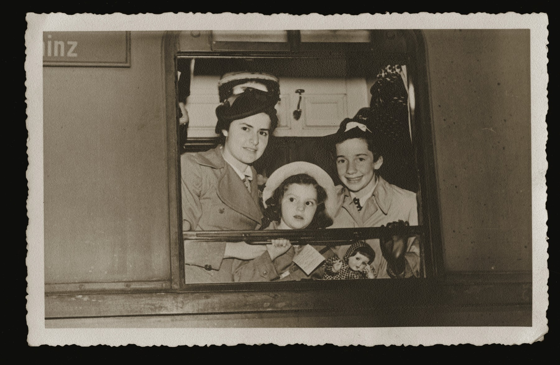 Beate Siegel (right) and two other girls look out a train window as they leave Germany on a Kindertransport to England.