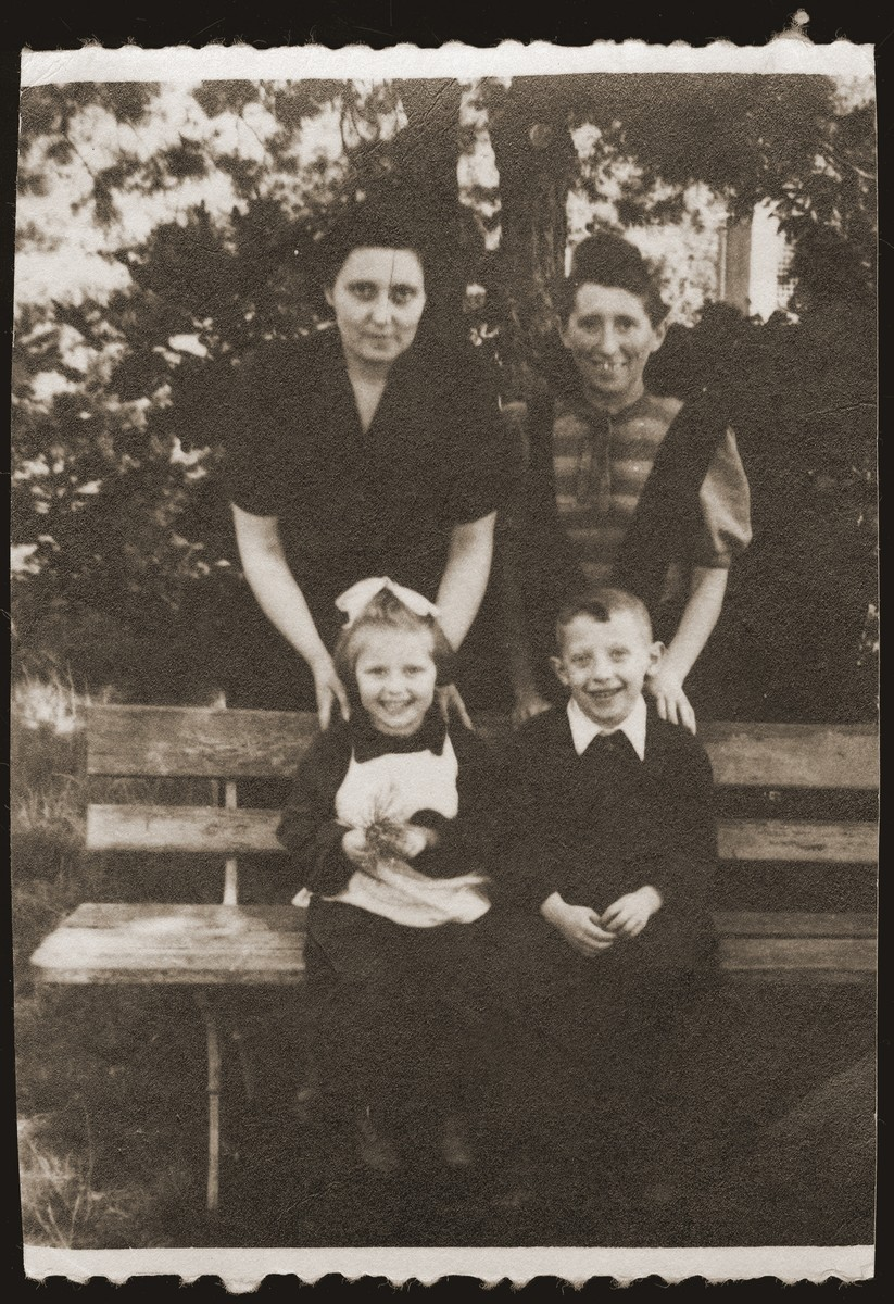 Mania Gryniewicz, right, and her friend, Guta Akierman pose with their children, Adam, right and Ania, during the parents day at a sanatorium for Jewish children in Srodborow, near Warsaw.