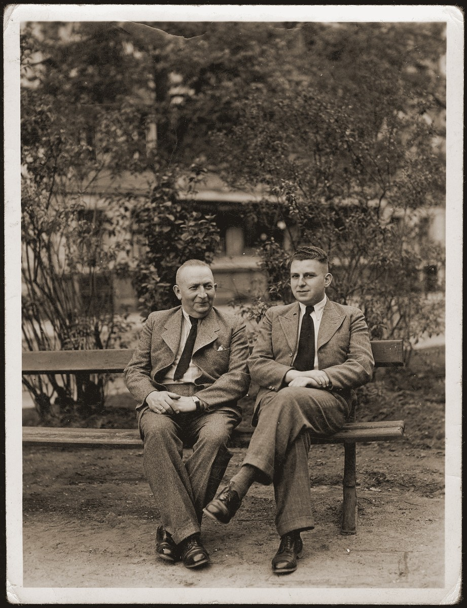 Walter and Siegfried Jacobsberg sit on a park bench in Berlin.