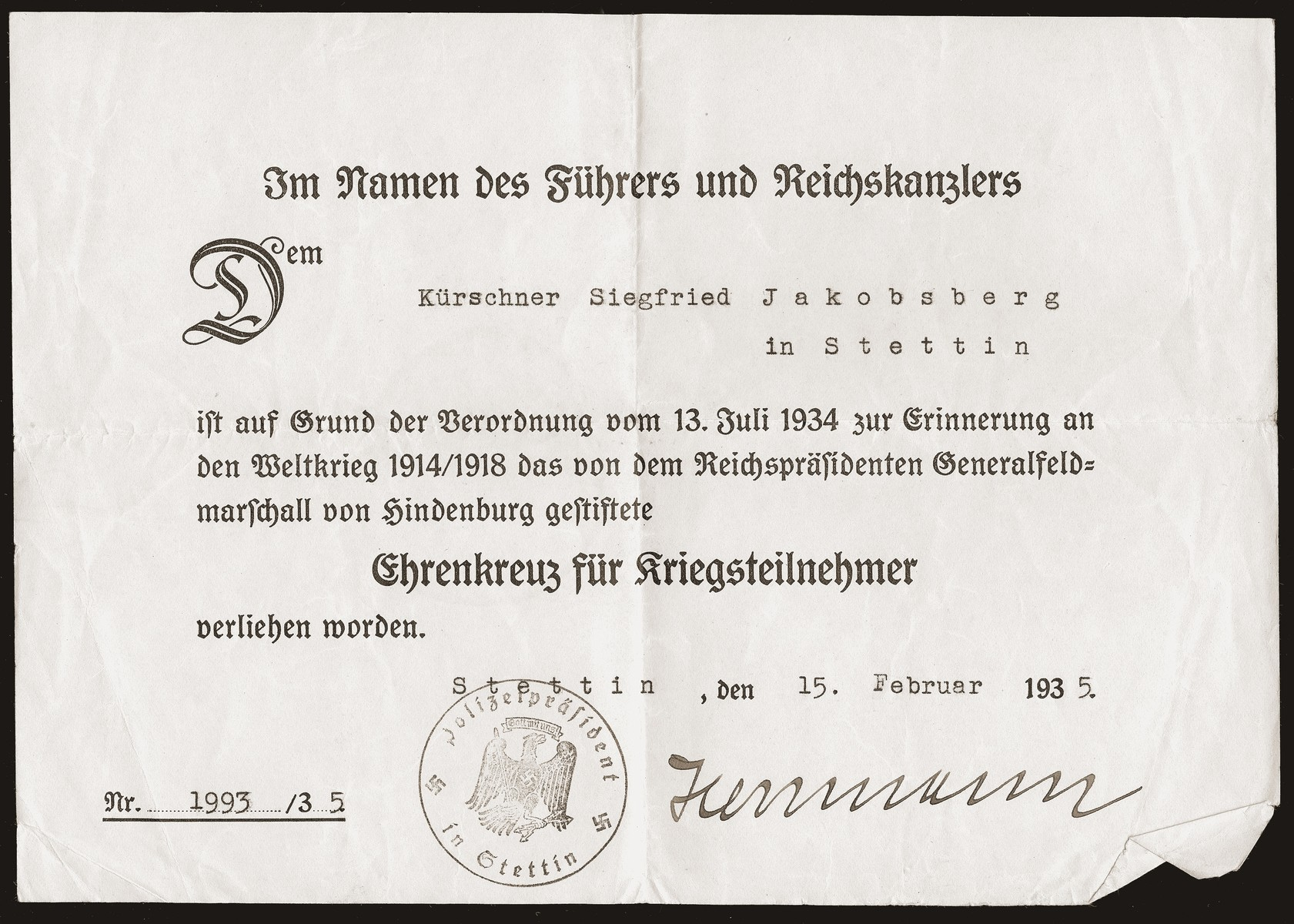 A certificate issued to Siegfried Jacobsberg recognizing him as a World War I veteran and recipient of a medal of honor.