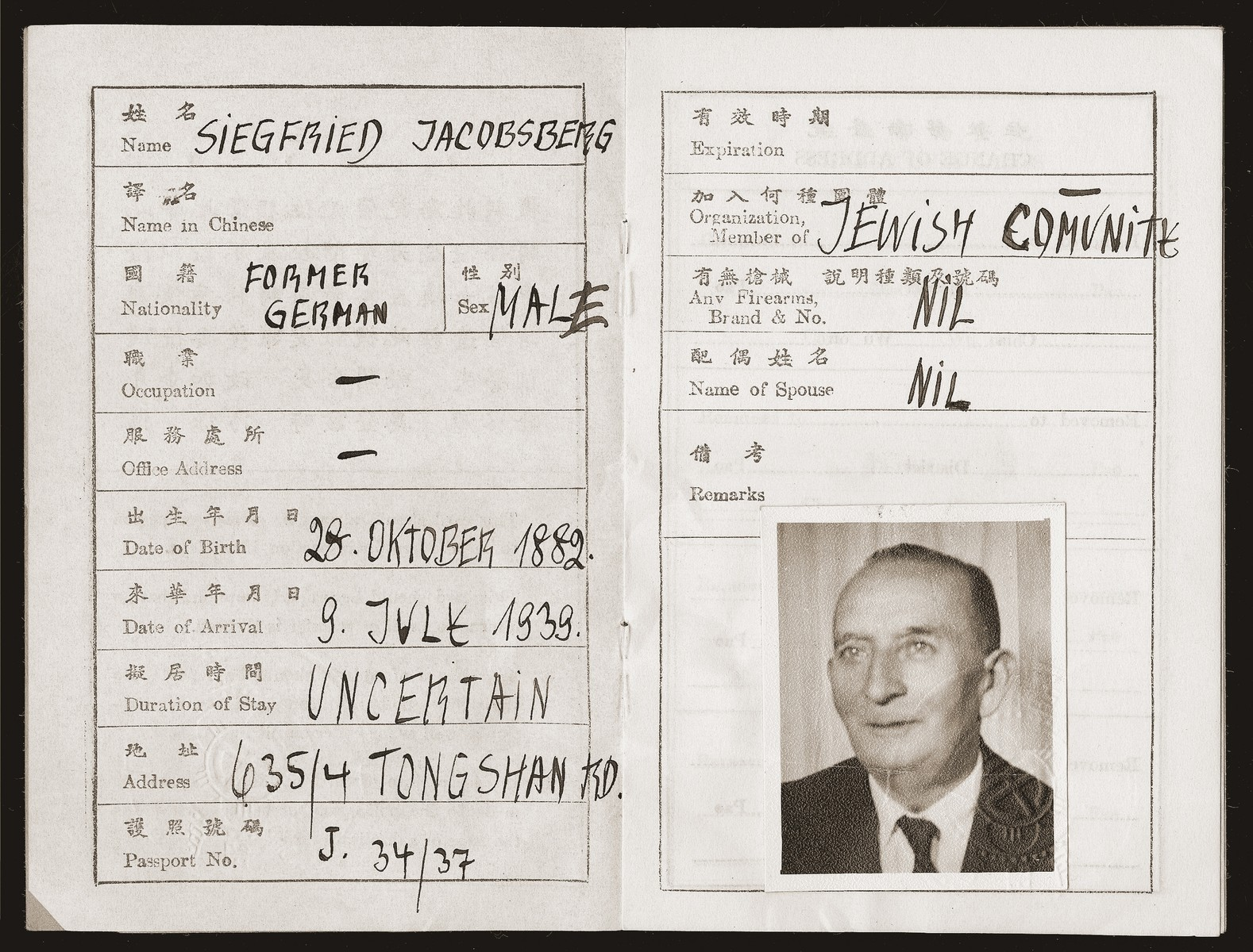 An identification document issued to Siegfried Jacobsberg in Shanghai.