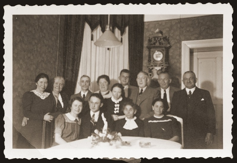 Gera and Alfred Borchart celebrate their engagement with friends and family at the Hettman home.    Walter and Siegfried Jacobsberg are pictured standing fourth and second from the right respectively.  Gera and Alfred Borchart were later deported to the Belzyce ghetto, where they were married on October 29, 1940.  The two perished two years later.