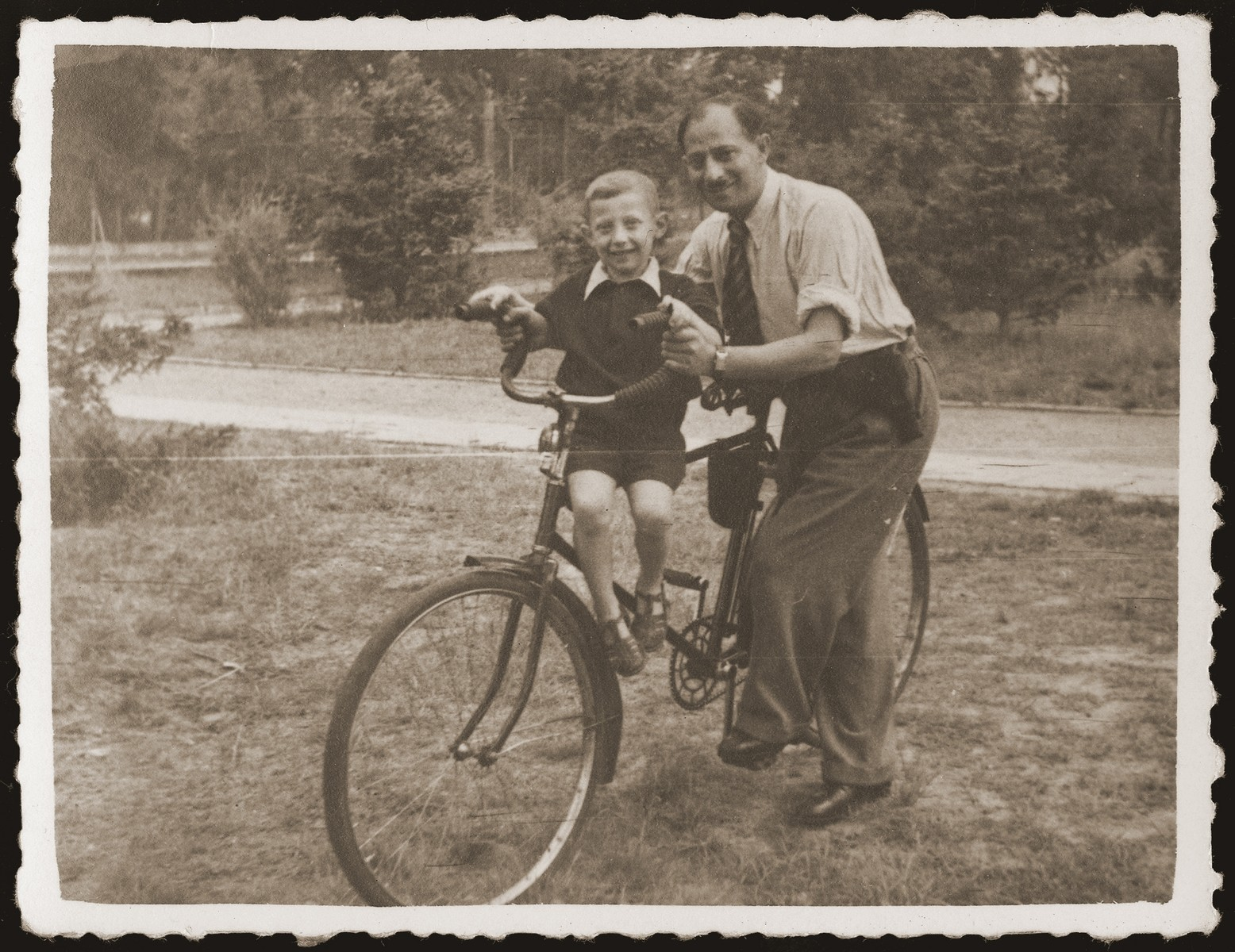 Gutman Gryniewicz and his son, Adam, pose for a picture, during a parents day in the sanatorium for Jewish children in Srodborow, near Warsaw.