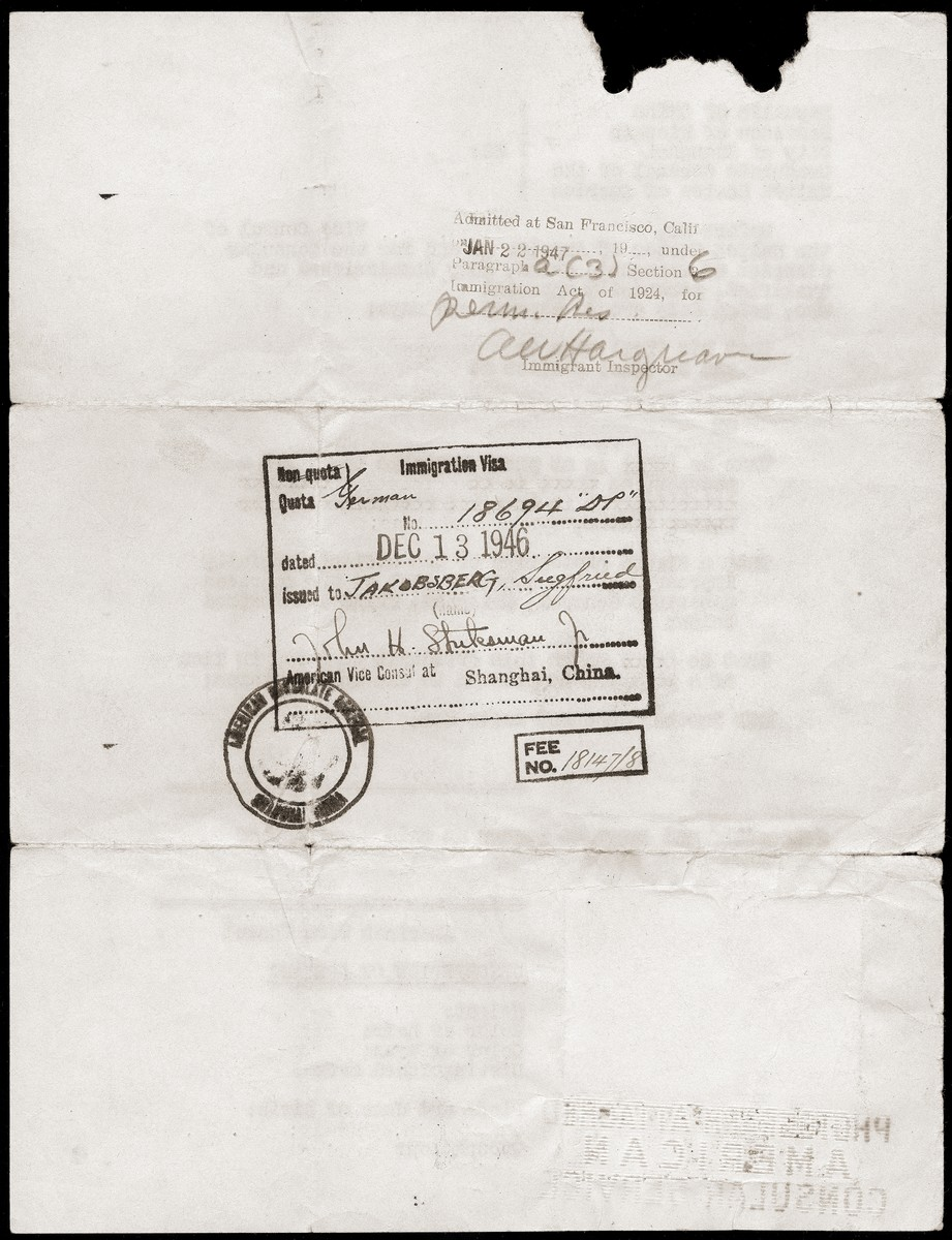 The second side of a travel document issued to Siegfried Jacobsberg by the United States Vice Consul in Shanghai featuring his immigration visa and arrival stamp.