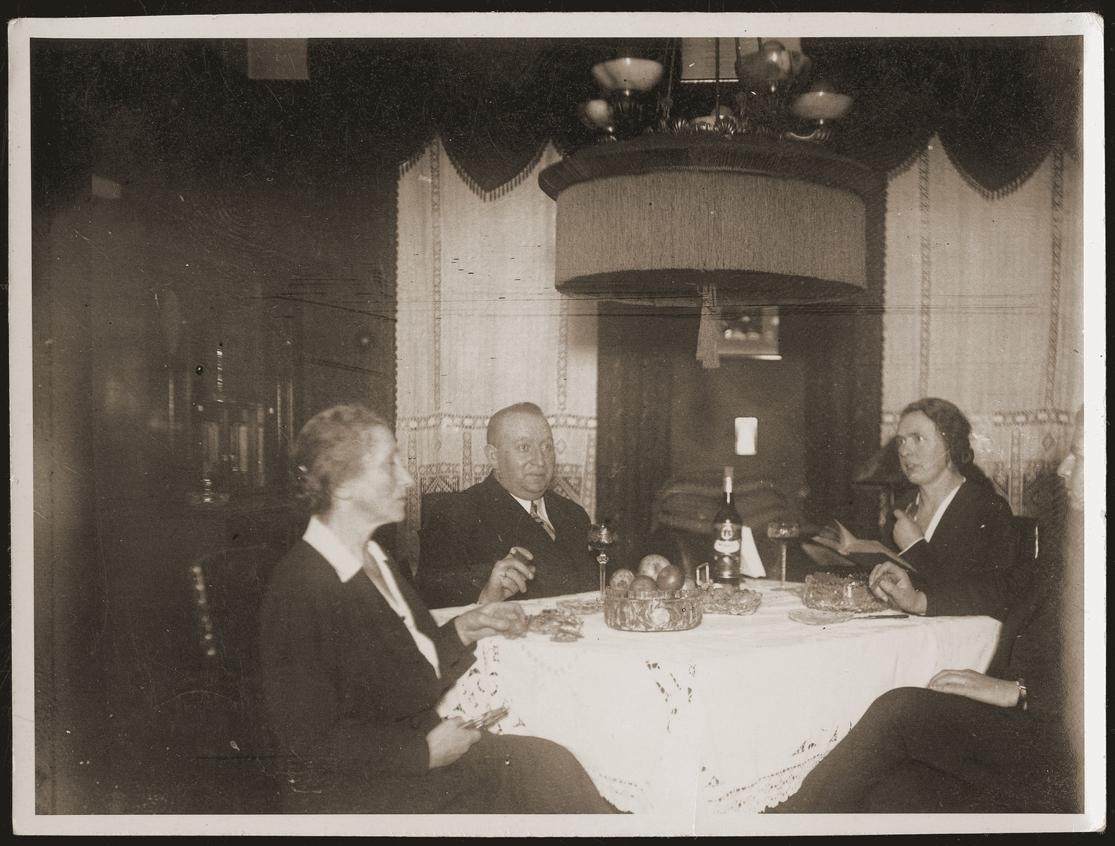 The Jacobsberg family celebrates Christmas with their German maid, Minna.    Pictured from left to right are Betti and Siegfried Jacobsberg, Minna, and Walter Jacobsberg.
