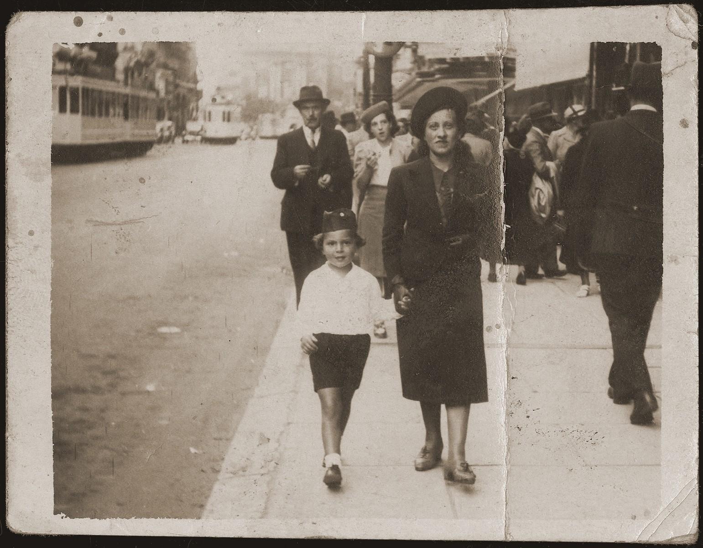 Pola Jakubowicz walks in the street with her nephew, Ester's son, Maurice Szykman.