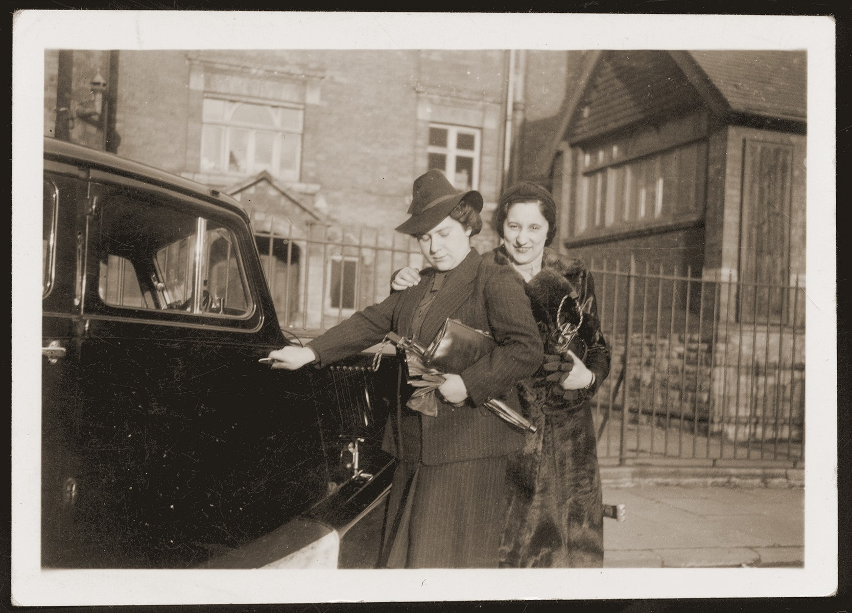 Hanne Loewenthal (left) and her friend, Ilse Suesskind, in front of the Loewenthal home in Stettin.  This photograph was sent by Hanne Loewenthal to her fiance, Walter Jacobsberg, in Shanghai.