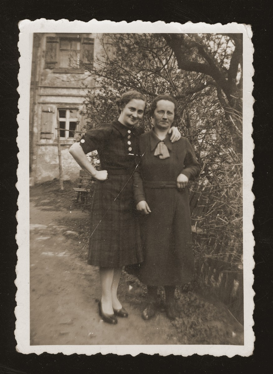 Flora Winter and her older sister, Marta, pose outside their home in Wittelshofen, Germany.