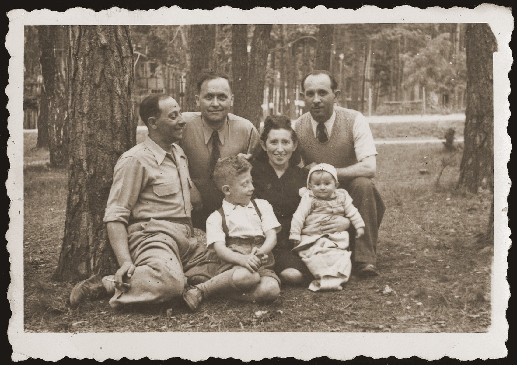 Mania Gryniewicz, seated, with her children, Hania and Adam.  Gutman, her husband, is on the left.  First from right is Victor Jakubowicz, Mania's brother, who visited from Belgium. Second from left is Mosze Stawski, brother-in-law of Kalman Jakubowicz.