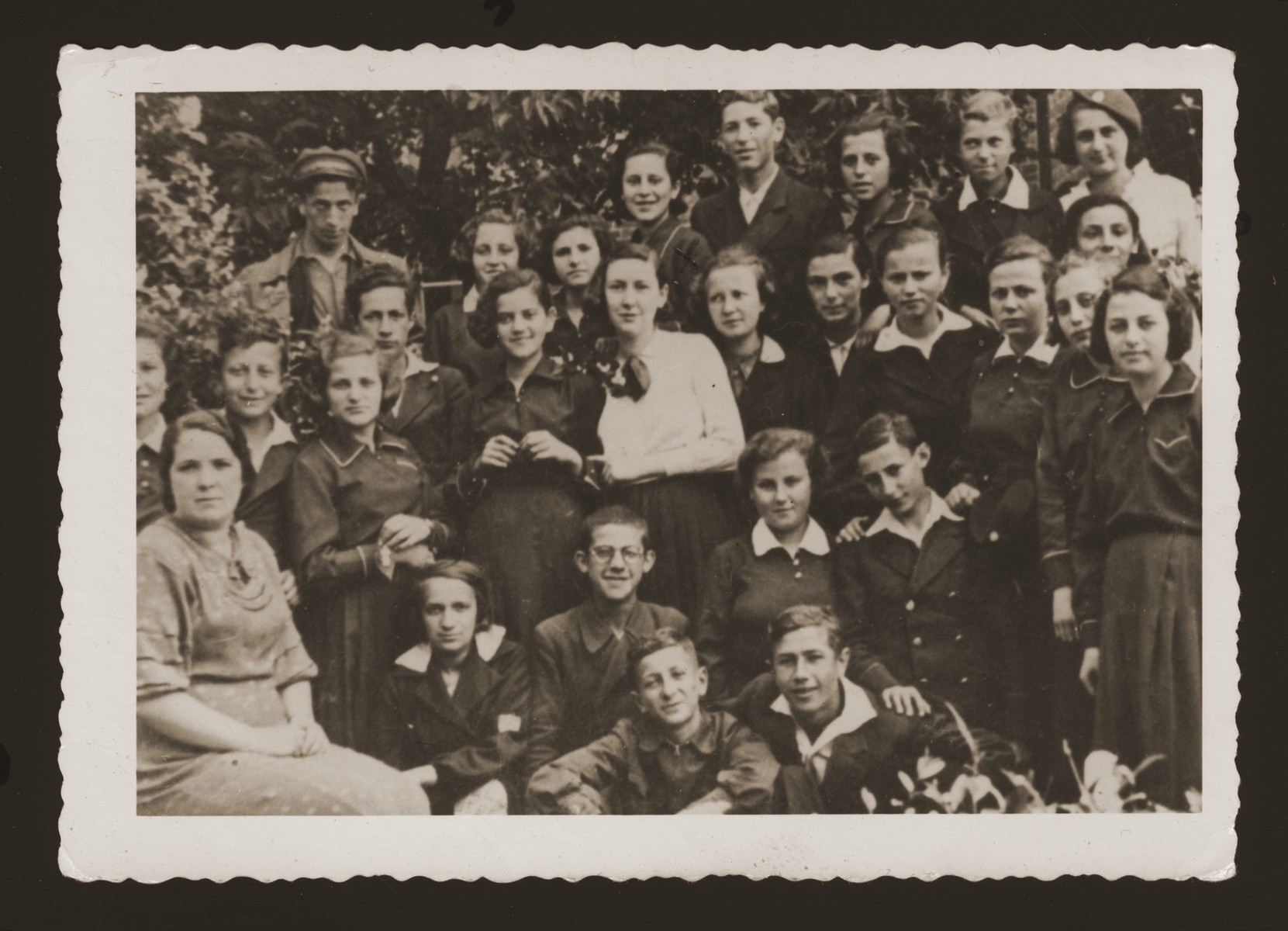 Group portrait of students from the Jewish gymnasium in Zamosc, Poland.  Irene Wechter is pictured is standing in the right front.