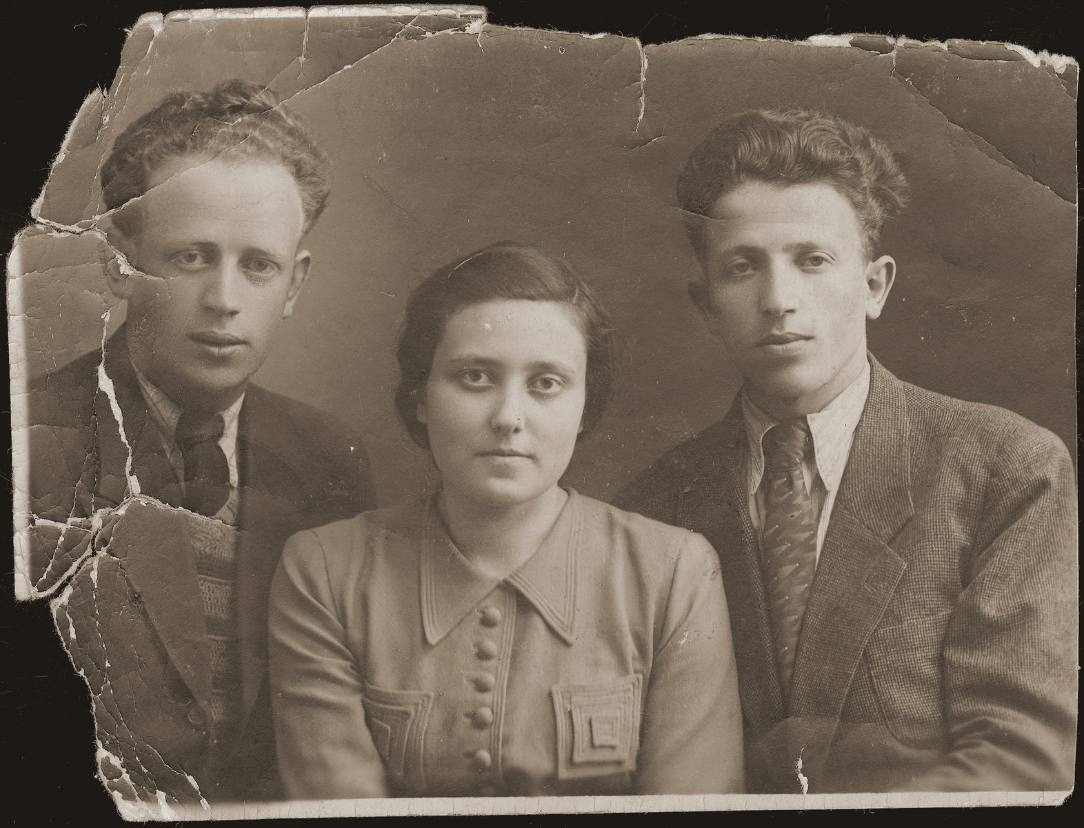 Portrait of Leon (right), Guta Akierman and their brother (name unknown).  Guta is the only survivor of her family.  The Akiermans were friends of the donor.