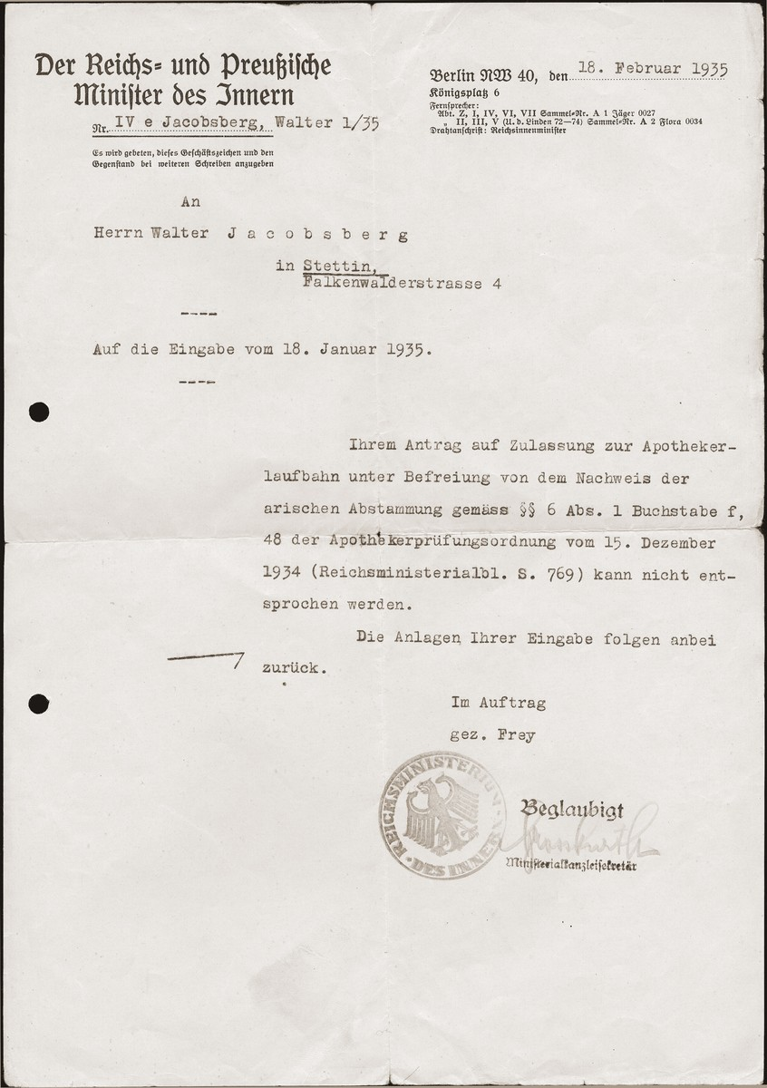 """A letter sent to Walter Jacobsberg by the German interior ministry, informing him that his application for admittance to a school of pharmacology has been rejected, due to his """"non-Aryan"""" status."""