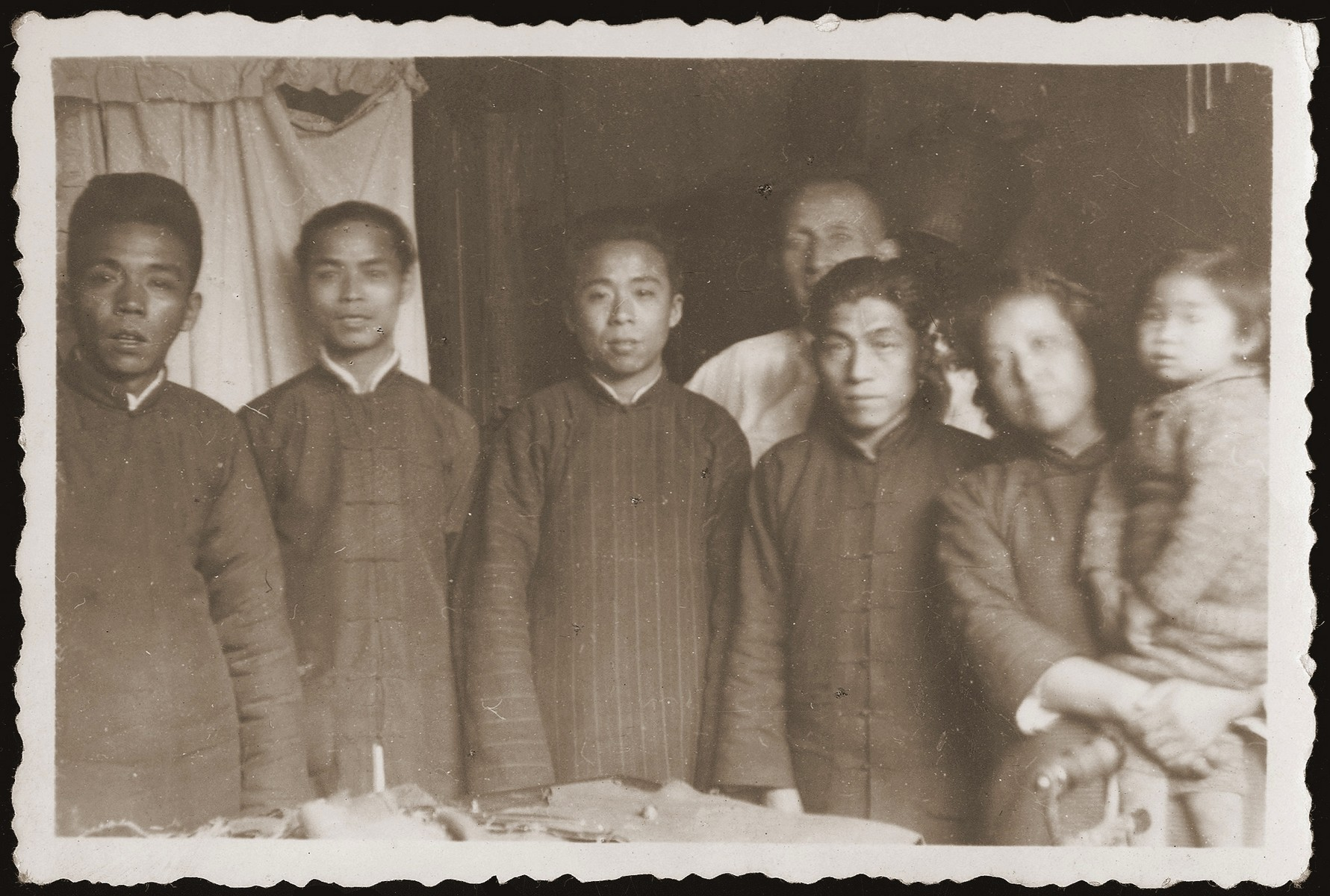 The family of a Chinese translator who worked with Walter Jacobsberg in Shanghai.  The Chinese civilian translated documents from Chinese to English, which Walter would then translate into German for the benefit of the German Jewish refugee community.