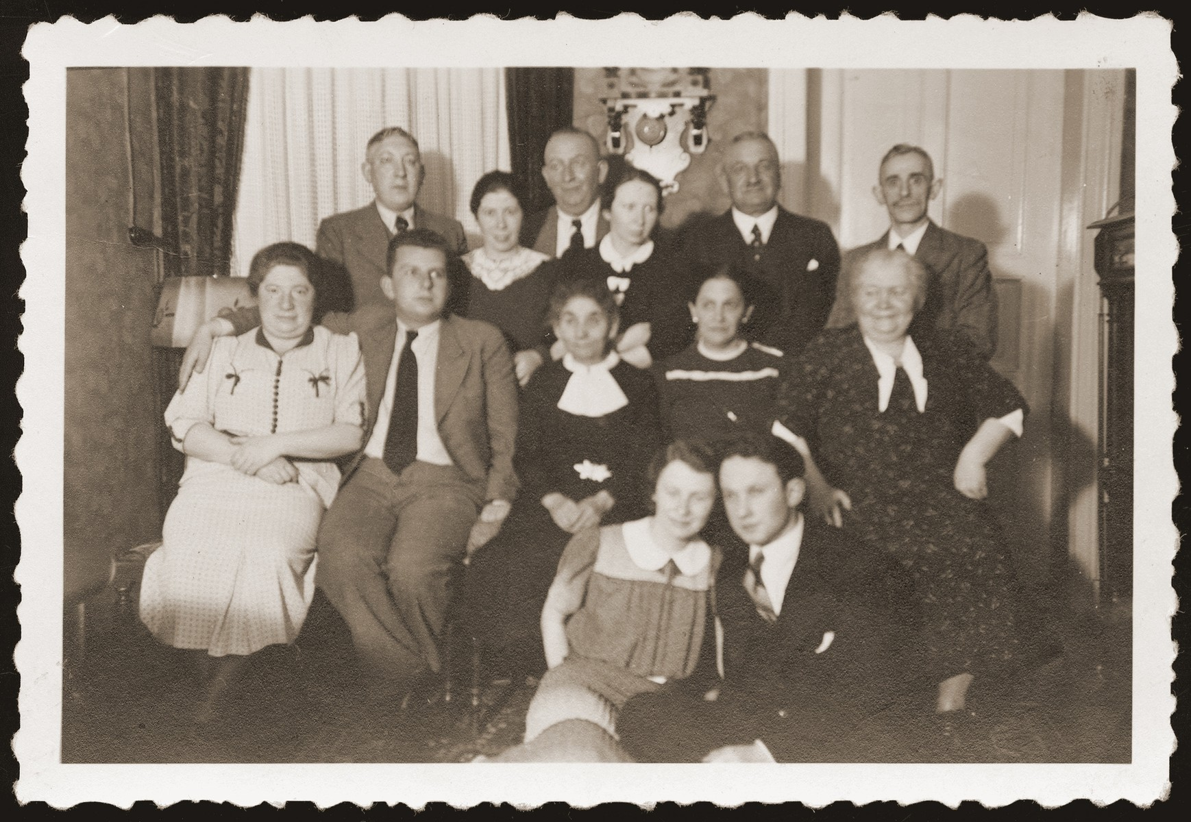 Gera and Alfred Borchart celebrate their engagement with friends and family at the Hettman home.    Pictured seated second from the left is Walter Jacobsberg.  His father, Siegfried, stands third from the left in the back.  Gera and Alfred Borchart were later deported to the Belzyce ghetto, where they were married on October 29, 1940.  The two perished two years later.