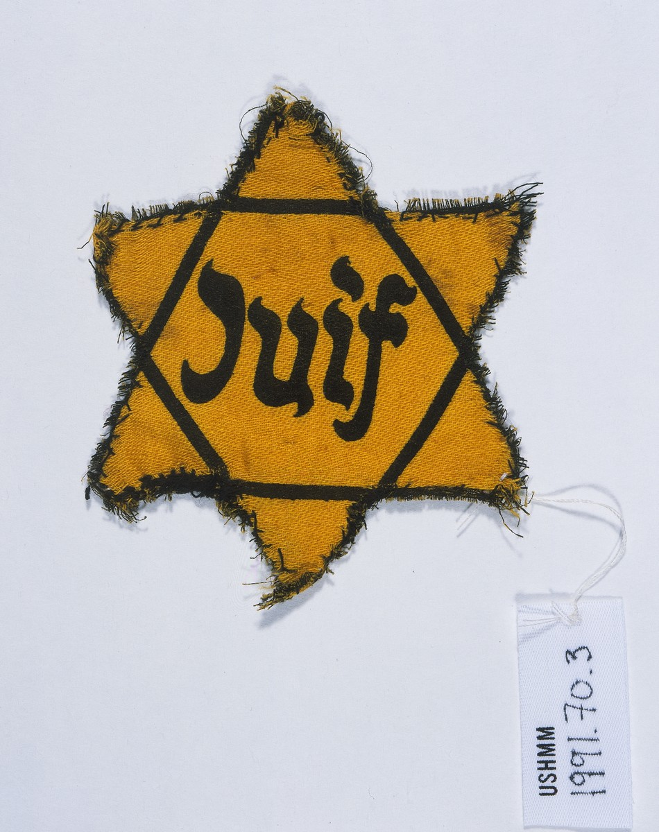 A yellow star of David with the French word for Jew (Juif) printed on it.
