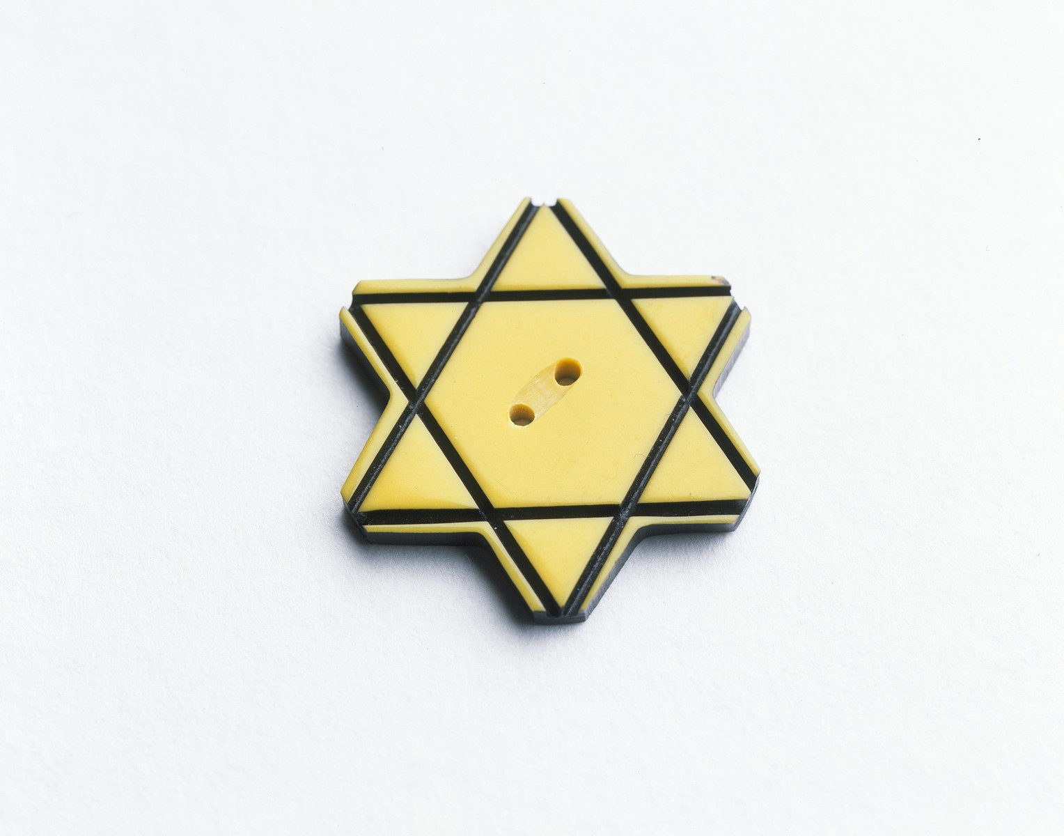 A star of David button worn by a member of Aaron Bally's family to identify the wearer as a Jew in Bulgaria.