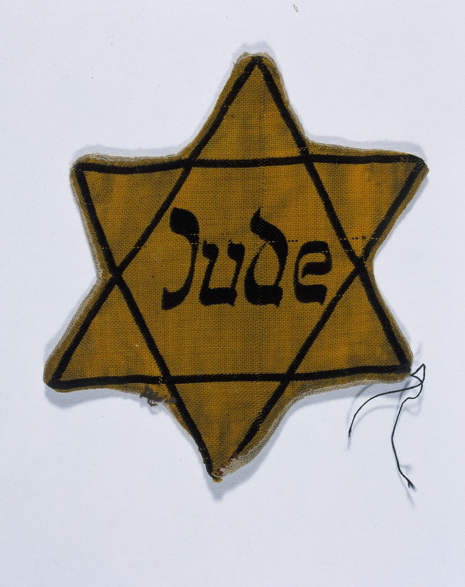 A yellow star of David marked with the German word for Jew (Jude) worn by Fritz Glueckstein.