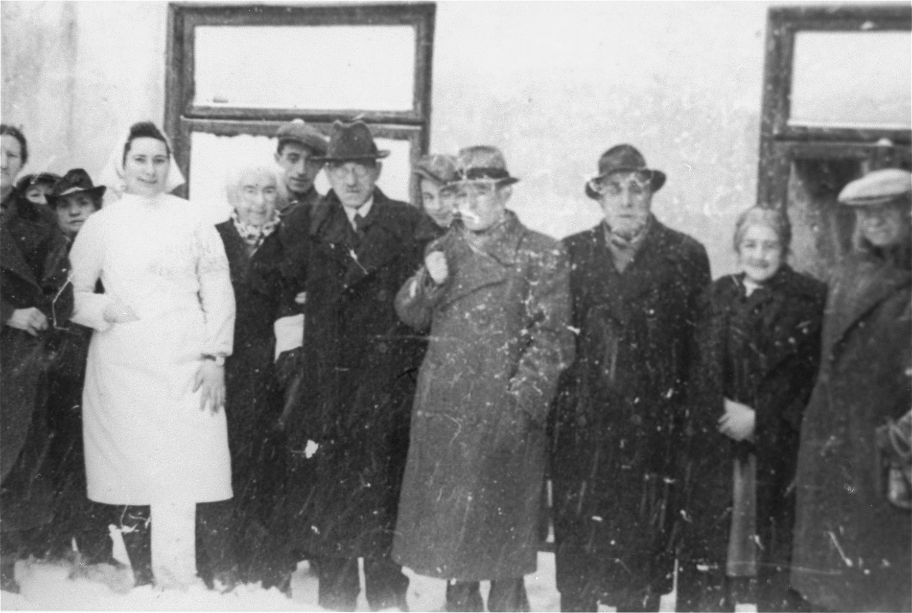 Group portrait of Jews from Vienna outside a home for the elderly in the Kielce ghetto.
