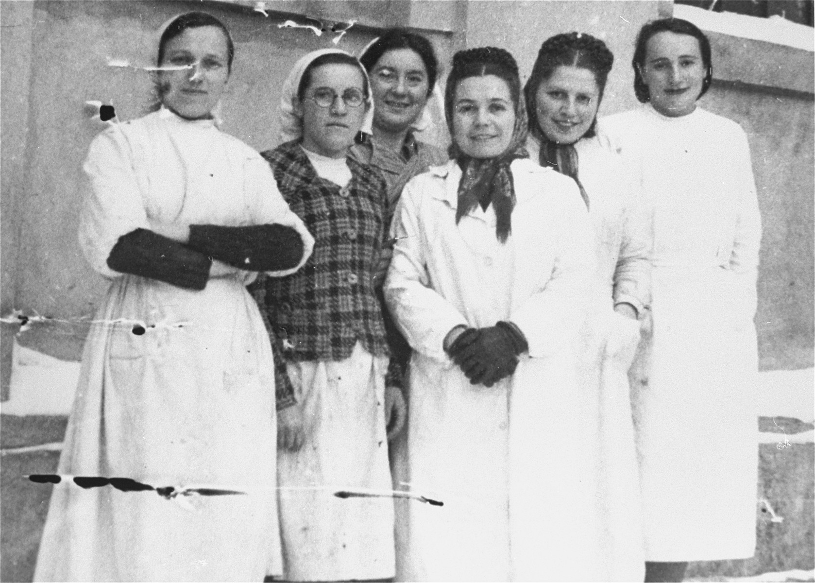 Group portrait of the staff of the soup kitchen in the Kielce ghetto.  This photo was one the images included in an official album prepared by the Judenrat (Jewish Council) of the Kielce ghetto in 1942.