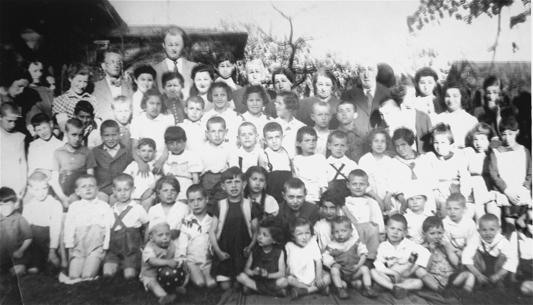 Group portrait of Jewish children in a day care program in the Kielce ghetto.
