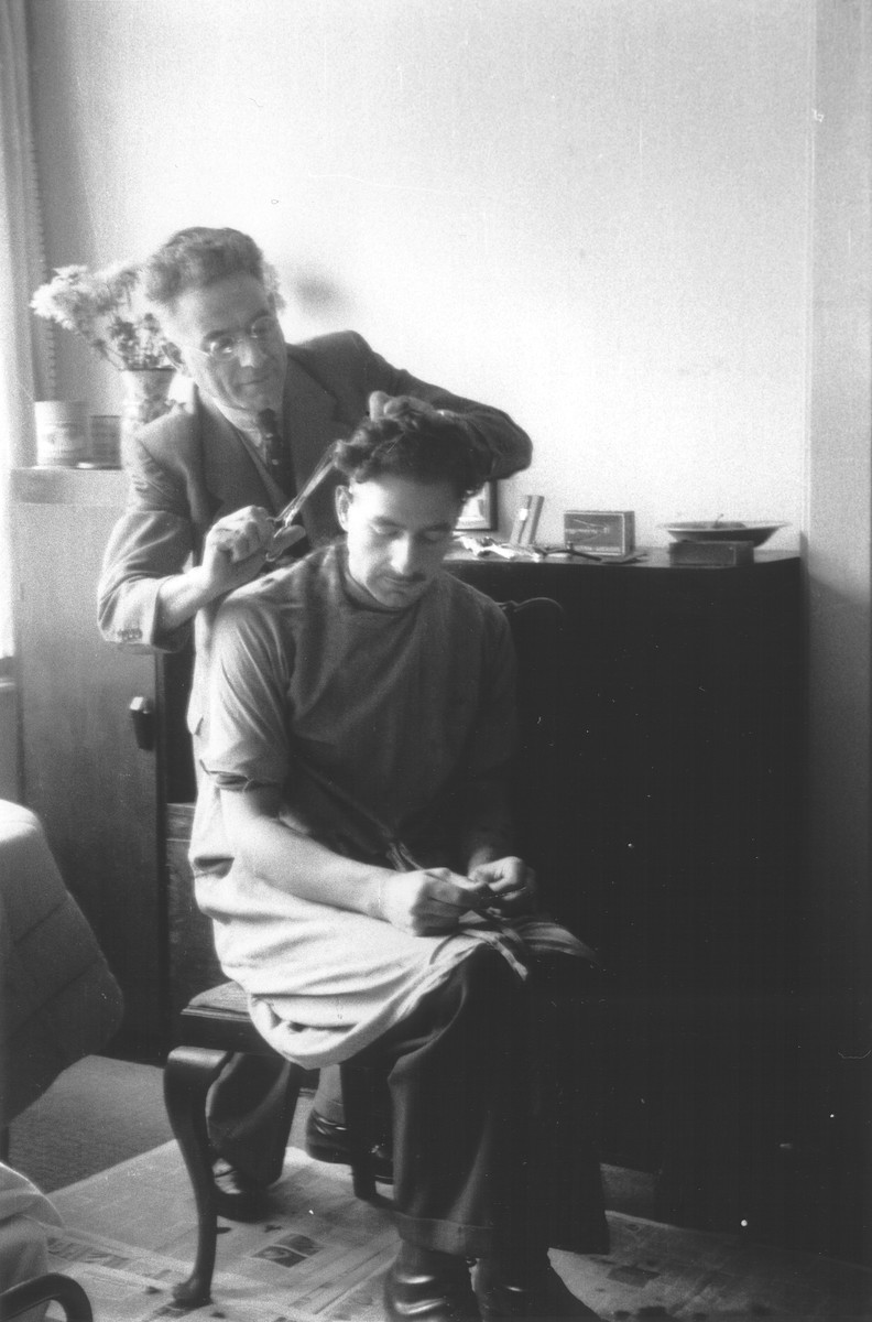 Asser Maurits Aussen gives his son Benno a haircut while in hiding in wartime Amsterdam.