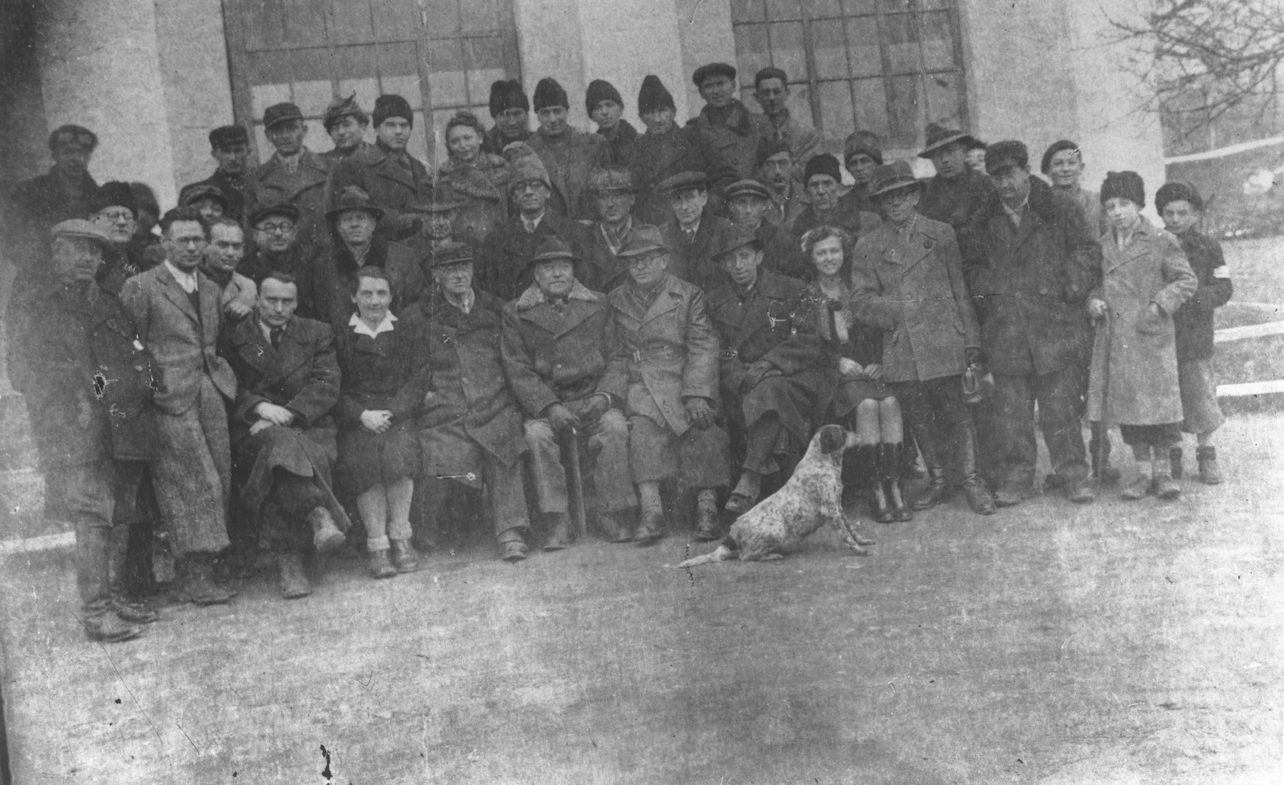 Group portrait of Jewish forced laborers at the Turnatoria, the machine shop established by Siegfried Jagendorf in the Mogilev-Podolskiy foundry.