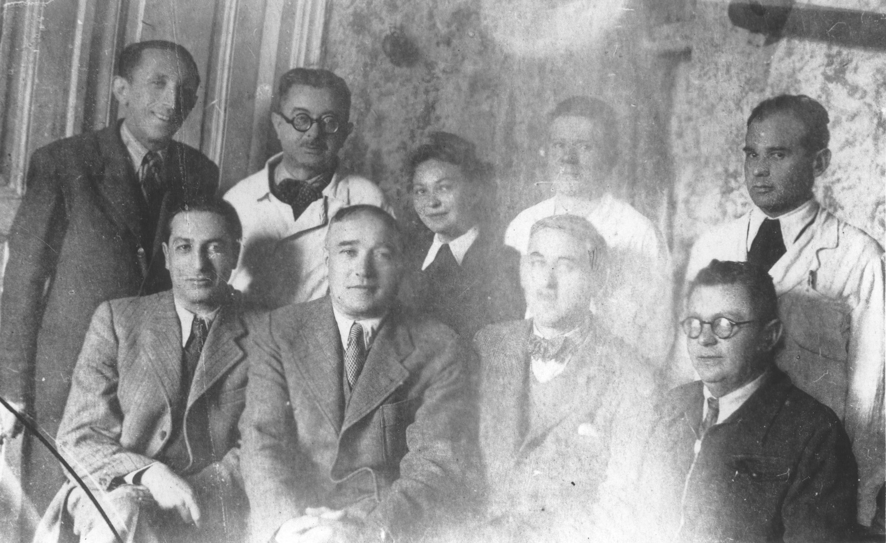 Group portrait of members of the medical staff of the Turnatoria, the machine shop established by Siegfried Jagendorf in the Mogilev-Podolskiy foundry.  Pictured from right to left in the front row are: Dr. B. Budick, Siegfried Jagendorf, Dr. F. Stern, Pinchas Katz.  In the second row are: Max Heissmann, [other identifications unclear].
