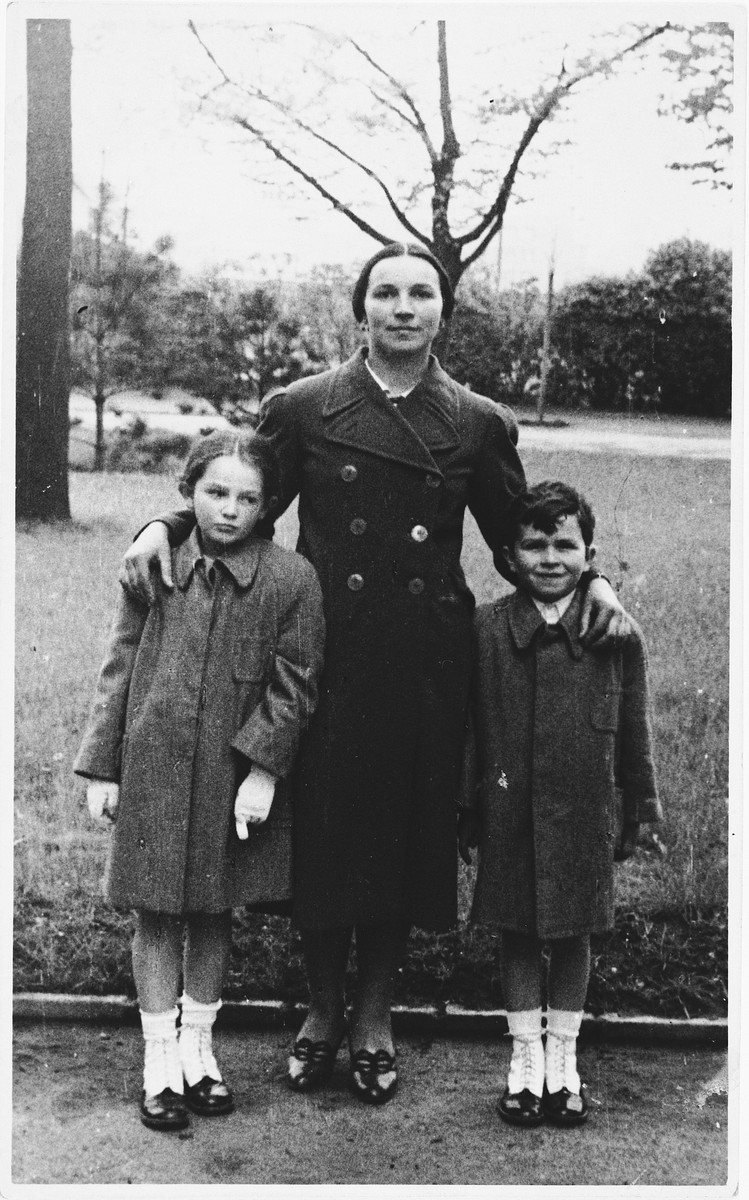 "Two Czech Jewish children pose in the park with their maid.  Pictured are the siblings, Nina and Peter Lederer.  Both children perished in Auschwitz.  One of Nina's drawings from Theresienstadt appears in ""I Never Saw Another Butterfly."""