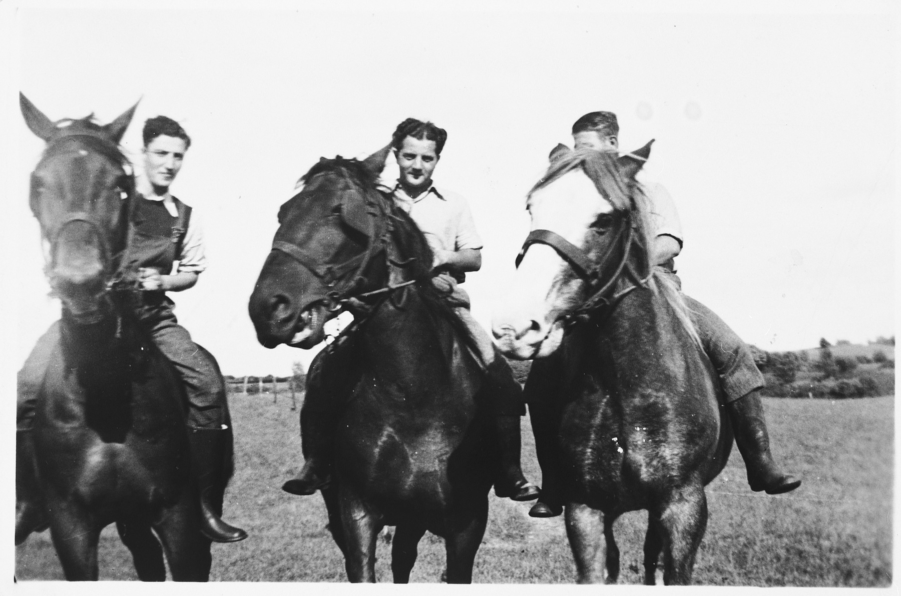 Three young Jewish refugees from Germany ride horses on a farm in the Jutland, where members of their hachshara [Zionist collective] are working.