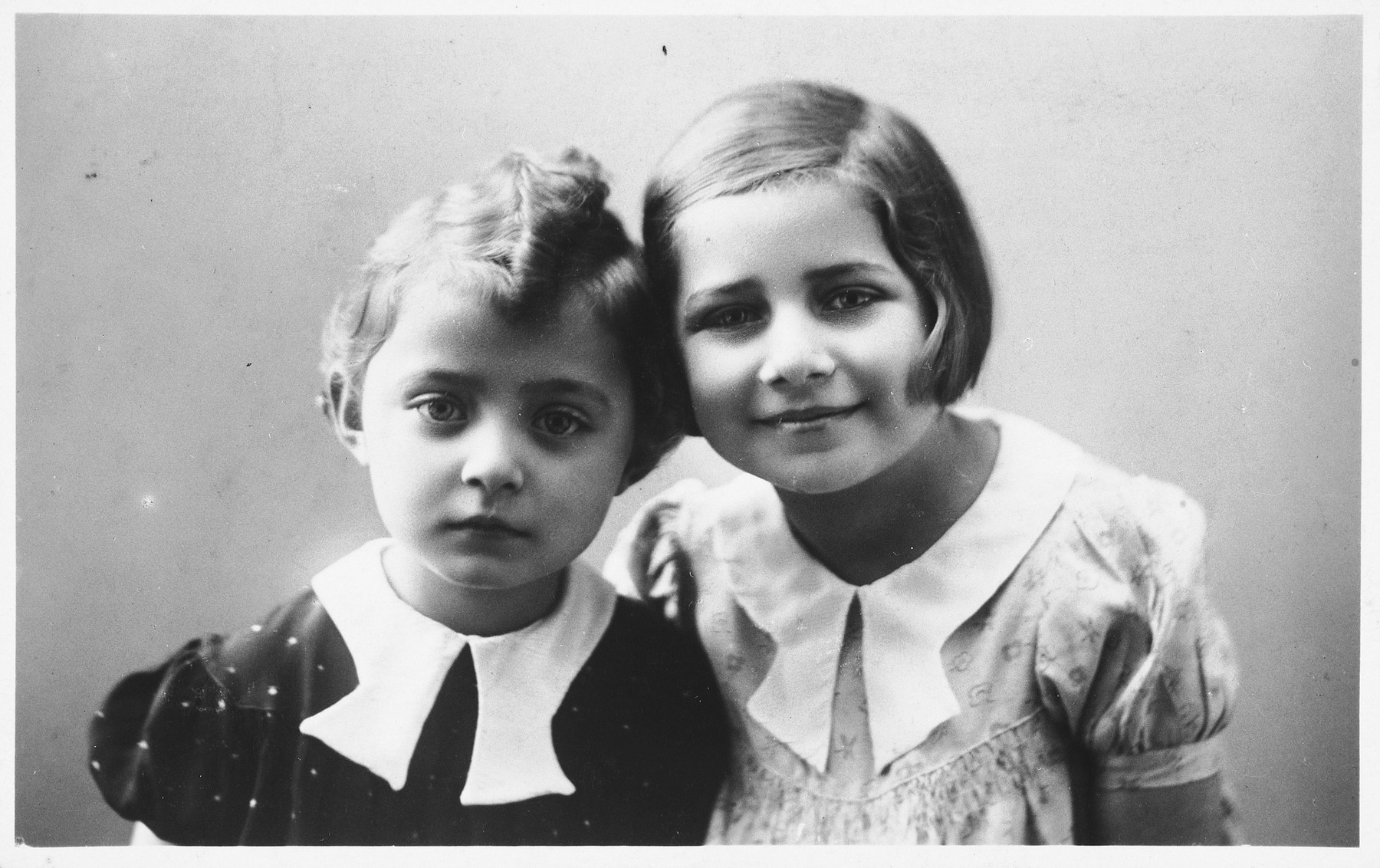 Studio portrait of two young Jewish sisters in Holice, Czechoslovakia.  Pictured are Gabriella and Katerina Frei.