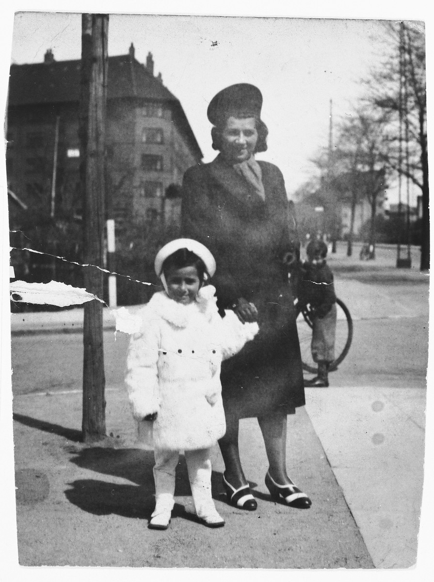 A Jewish mother poses with her daughter on a street corner in the Bispebjerg section of Copenhagen.  Pictured are Kaja (Diament) Geldmann with her daughter Birthie.
