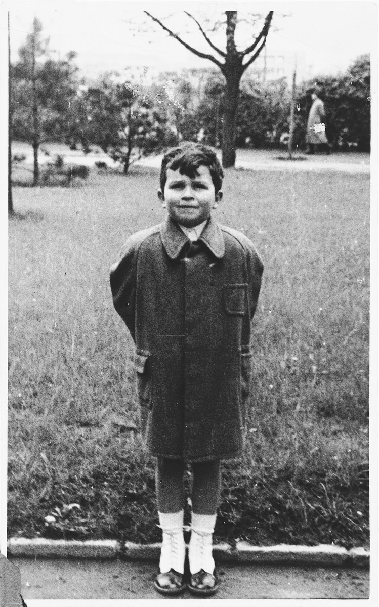 Portrait of a Czech Jewish boy standing outside.  Pictured is Peter Lederer, who later perished in Auschwitz.