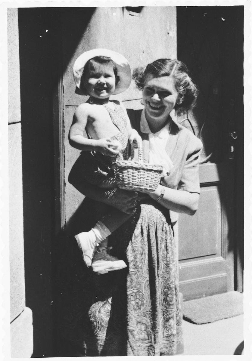 Ilma Lichtig holds her daughter Adrienne.