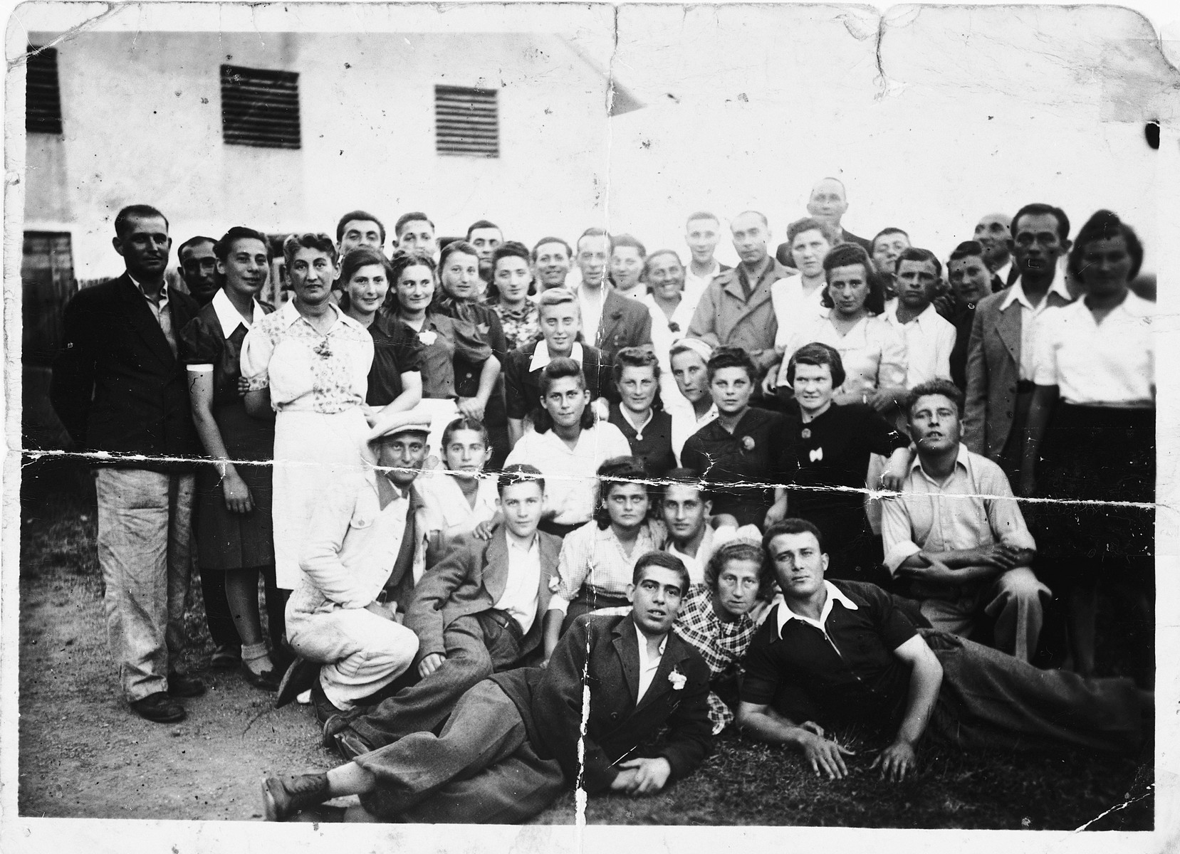 Group portrait of Jewish survivors who were liberated near Landsberg, Germany.