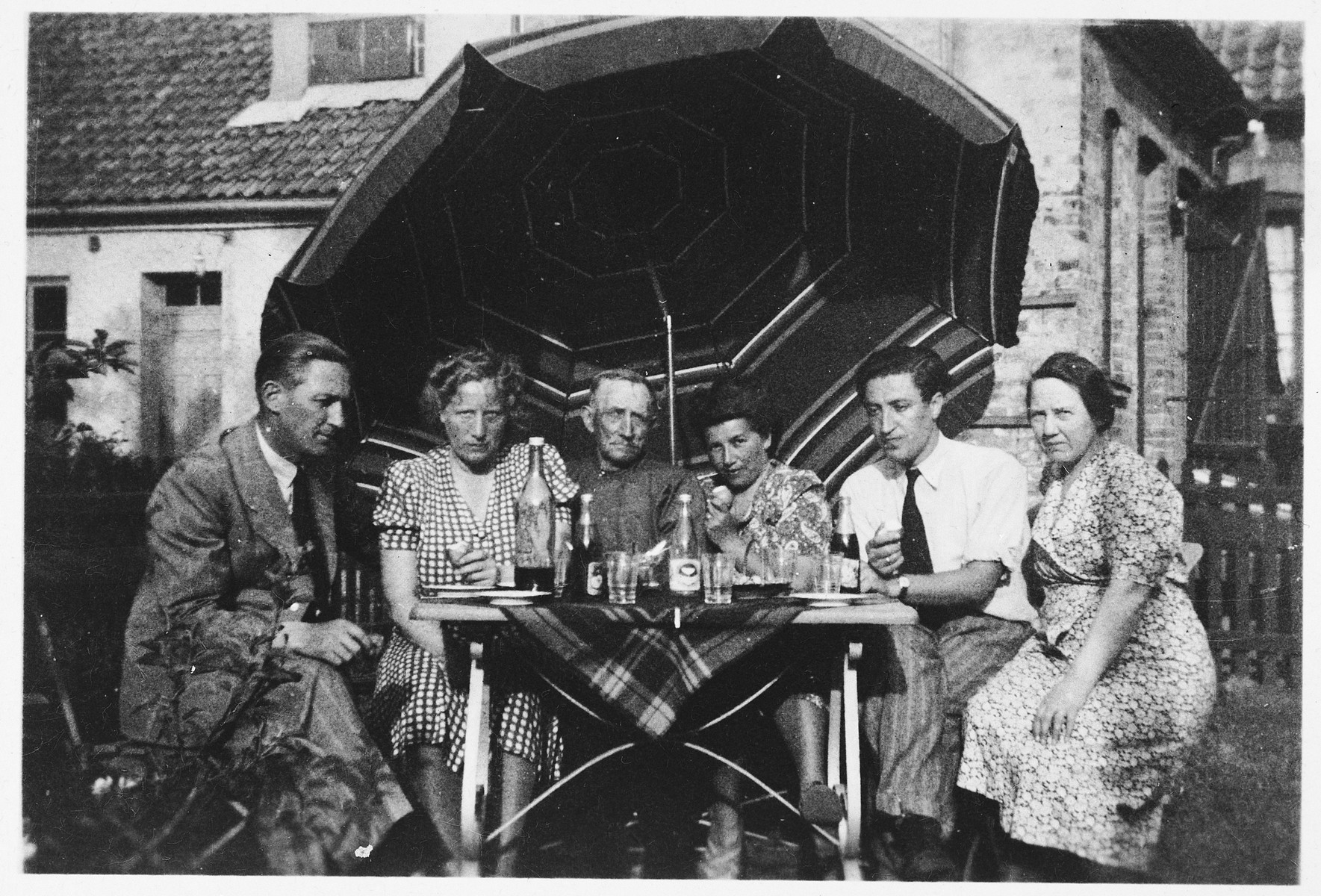 A Jewish couple from Denmark who was ferried to safety in Sweden poses with the Swedish family who hosted them in the backyard of their home in Landskrona.  Pictured from left to right are Mane and Daisy Magnuson, Manes brother, Kaja and Josef Geldmann, and Mane's sister.