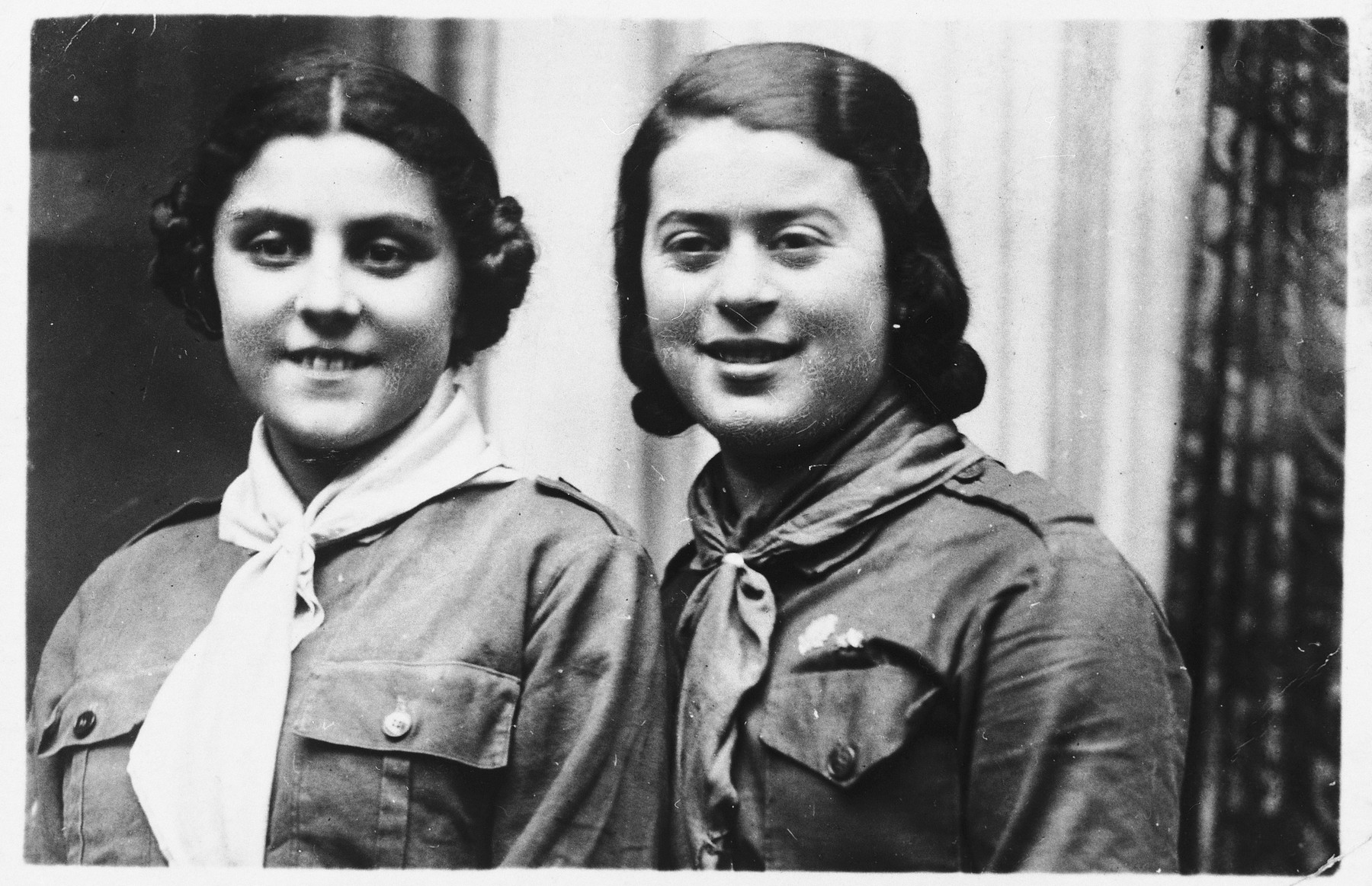 Portrait of two teenage girls who are members of the Hashomer Hatzair Zionist youth movement in Kalisz, Poland.