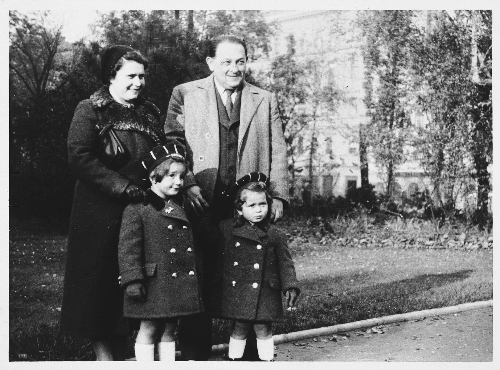"A Jewish family poses in a park in Prague.  Pictured are Robert and Rose Lederer and their two children, Nina and Peter, all of whom perished during World War II.  One of Nina's drawings from Theresienstadt appears in ""I Never Saw Another Butterfly."""