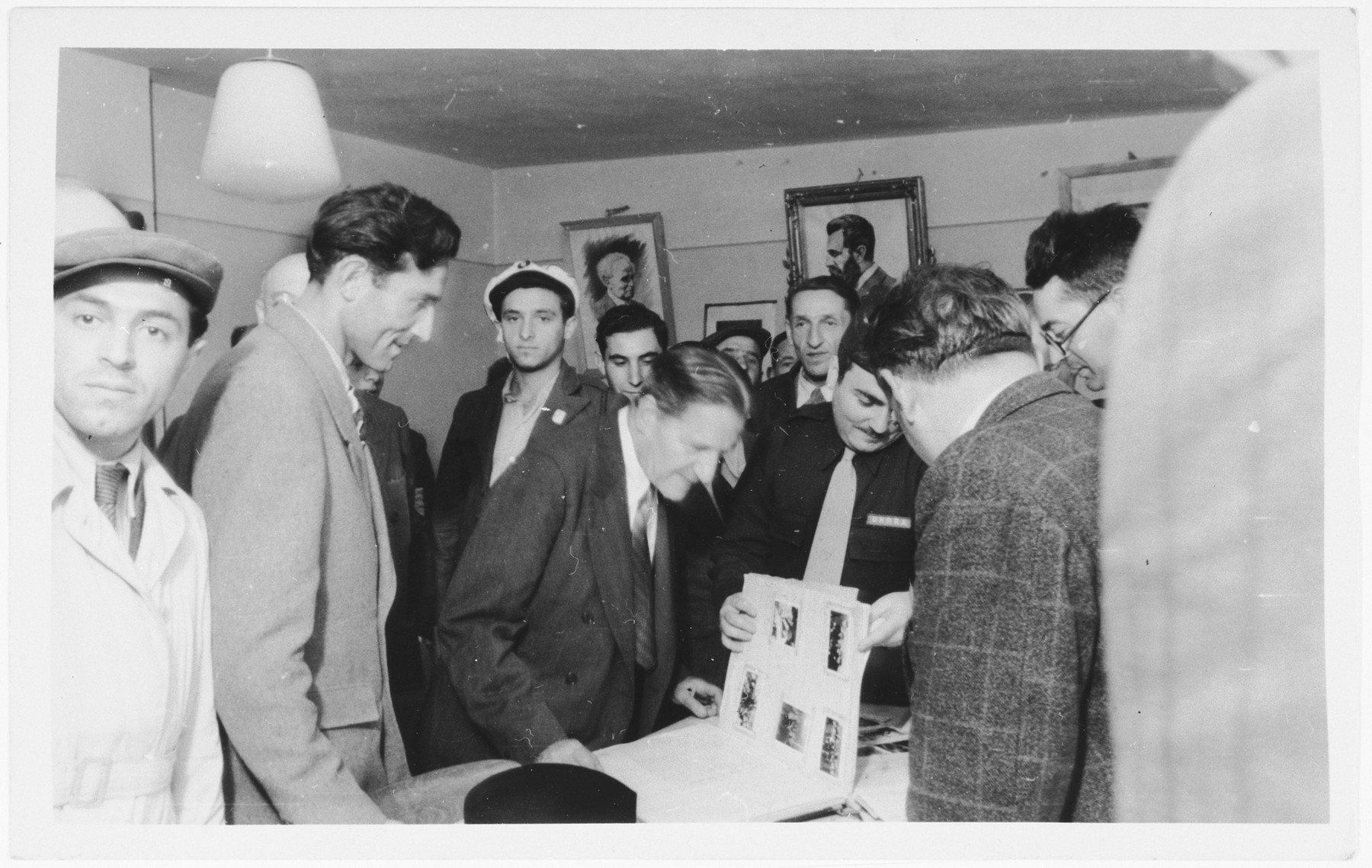 Rabbi Stephen Wise looks at a photo album during his visit to the Zeilsheim displaced persons' camp.