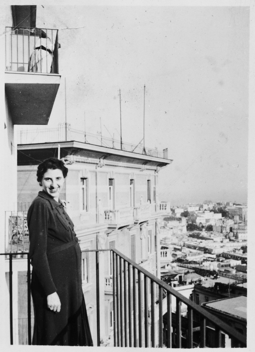 Lisa Foa stands on the balcony of their home overlooking the city of Naples.