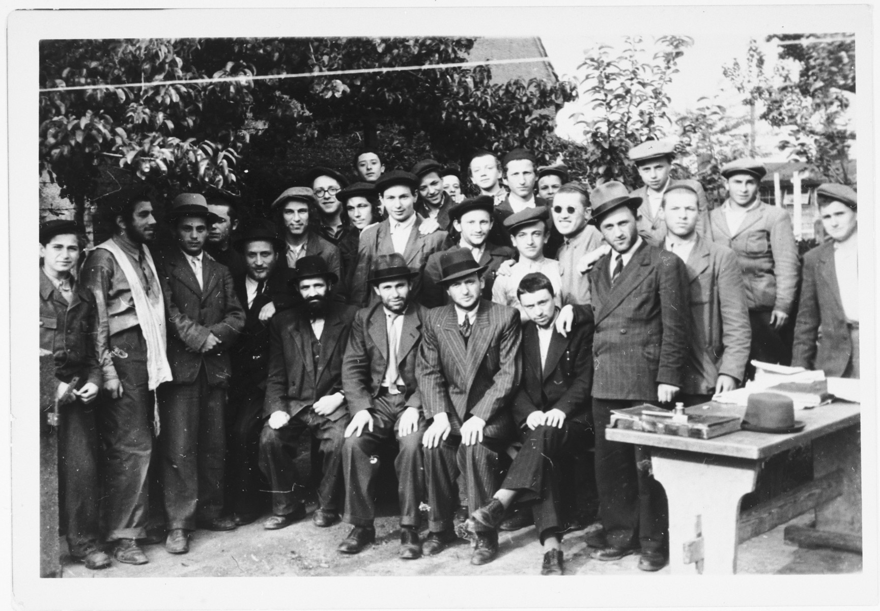 Group protrait of Orthodox men and boys [probably yeshiva students] in the Zeilsheim displaced persons' camp.