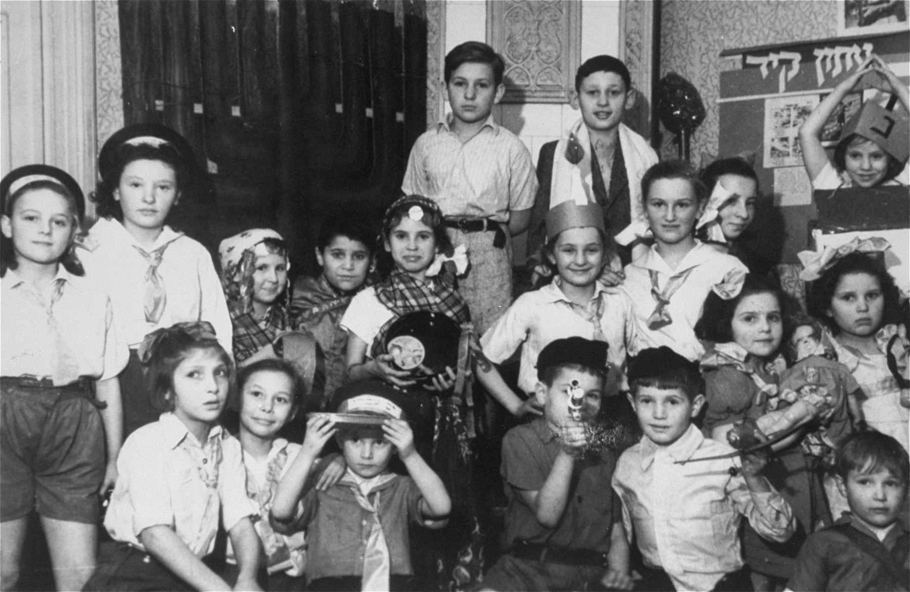 Hanukkah celebration at an orphanage for Jewish children in Lodz run by the Koordynacja (Coordination Committee).   All of the children at the home had been hidden by Christian families during the war.