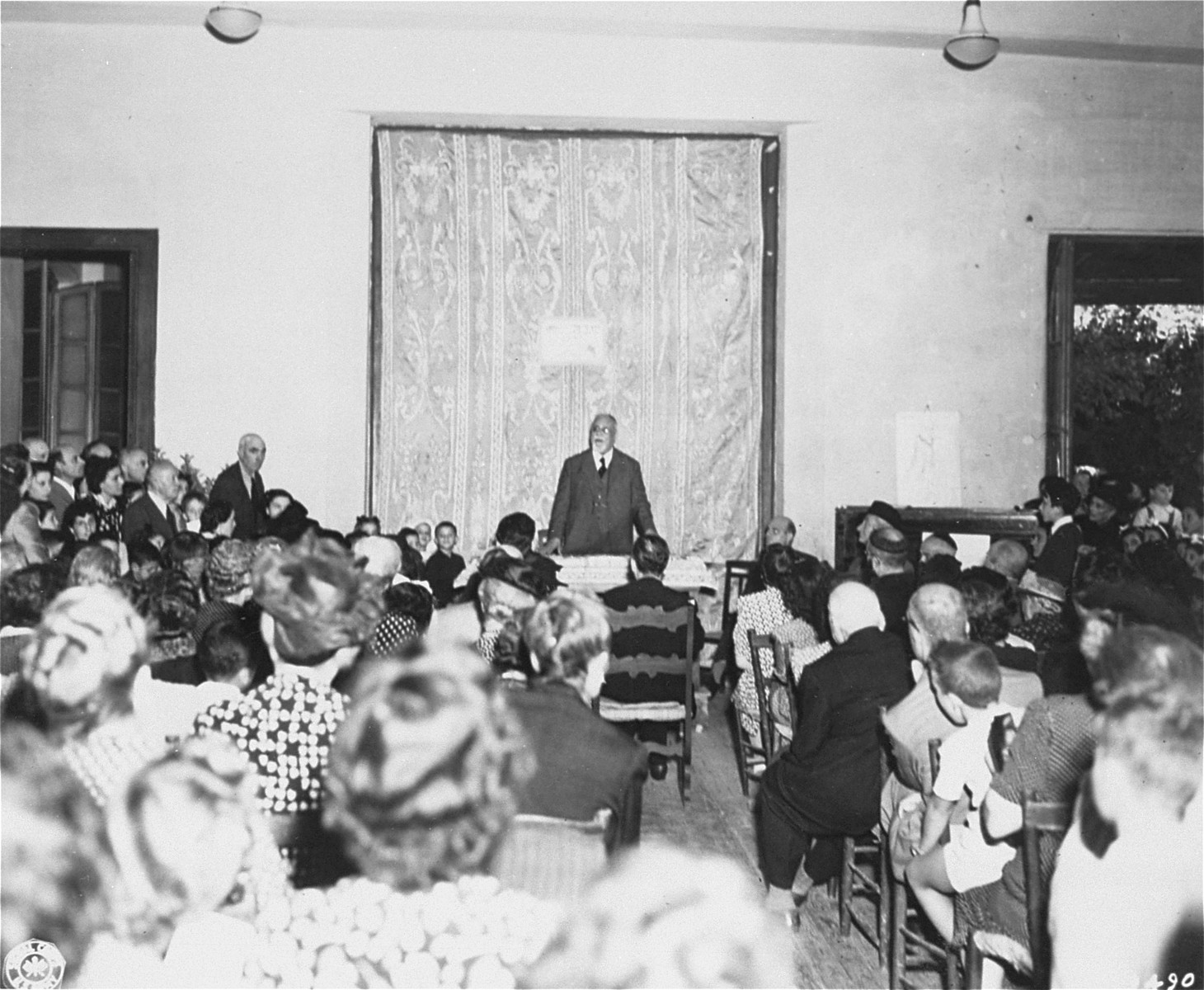 Rabbi David Prato, Chief Rabbi of Rome, speaks to a large congregation during ceremonies at the Jewish Orphanage in Rome.