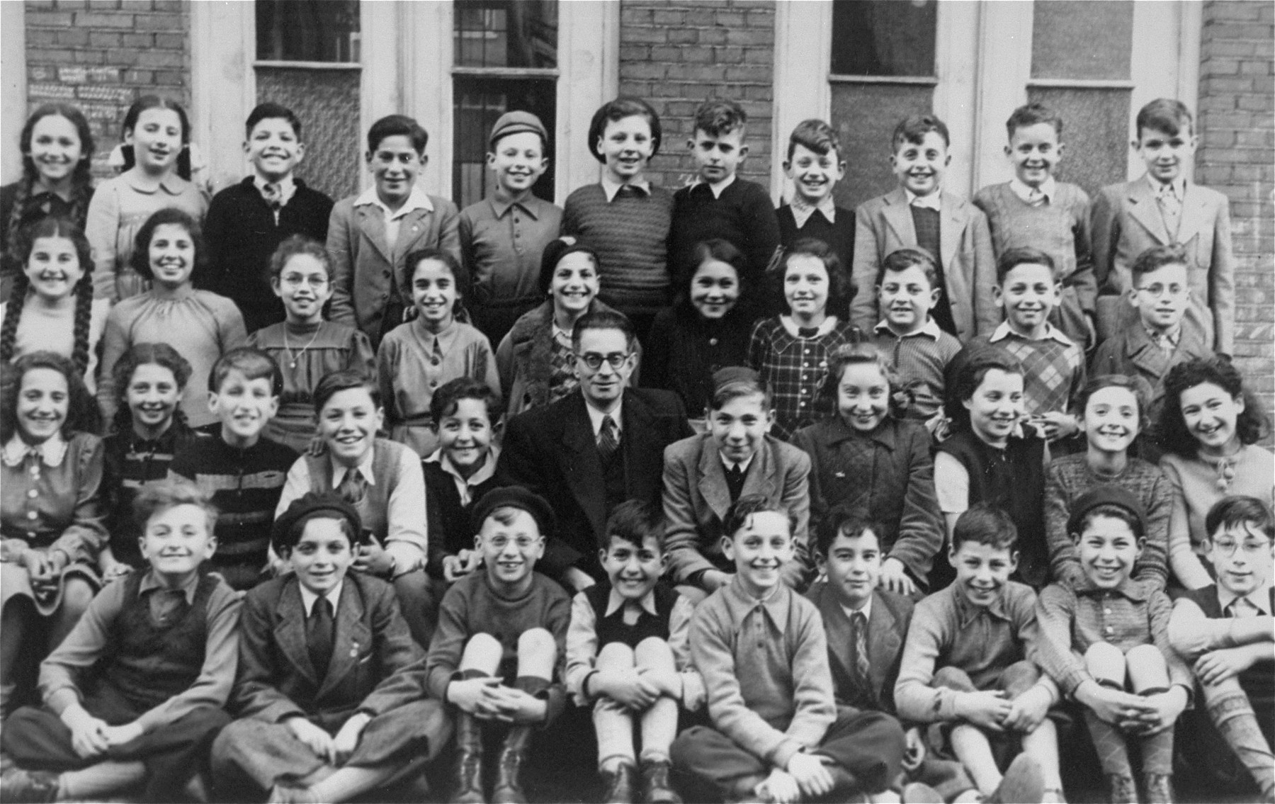 Third grade class at Rosh Pina Hebrew Day School where Marion Kaufmann was a student.    She is last on the right in the second row from the bottom.  Most of these children left by Kinder Aliyah to Israel.