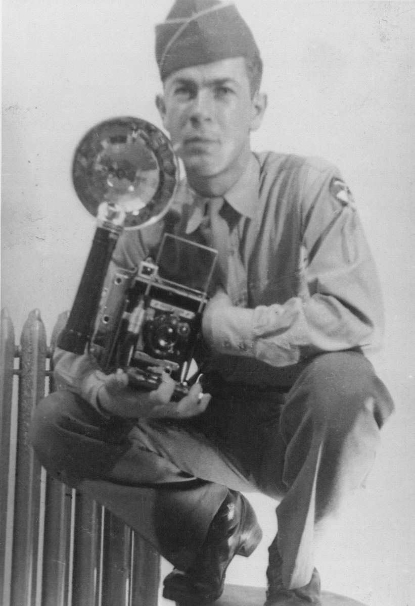 Paul Averitt, a member of the US Army 92nd Signal Corps Battalion poses with his camera.