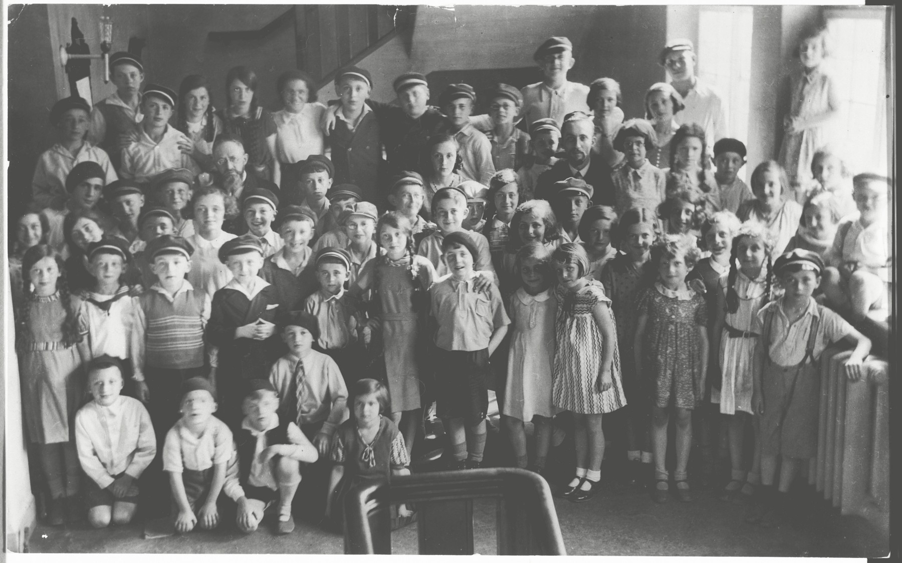 Rabbi Baruch Posner poses with the children in his Sunday religious school in Kiel.